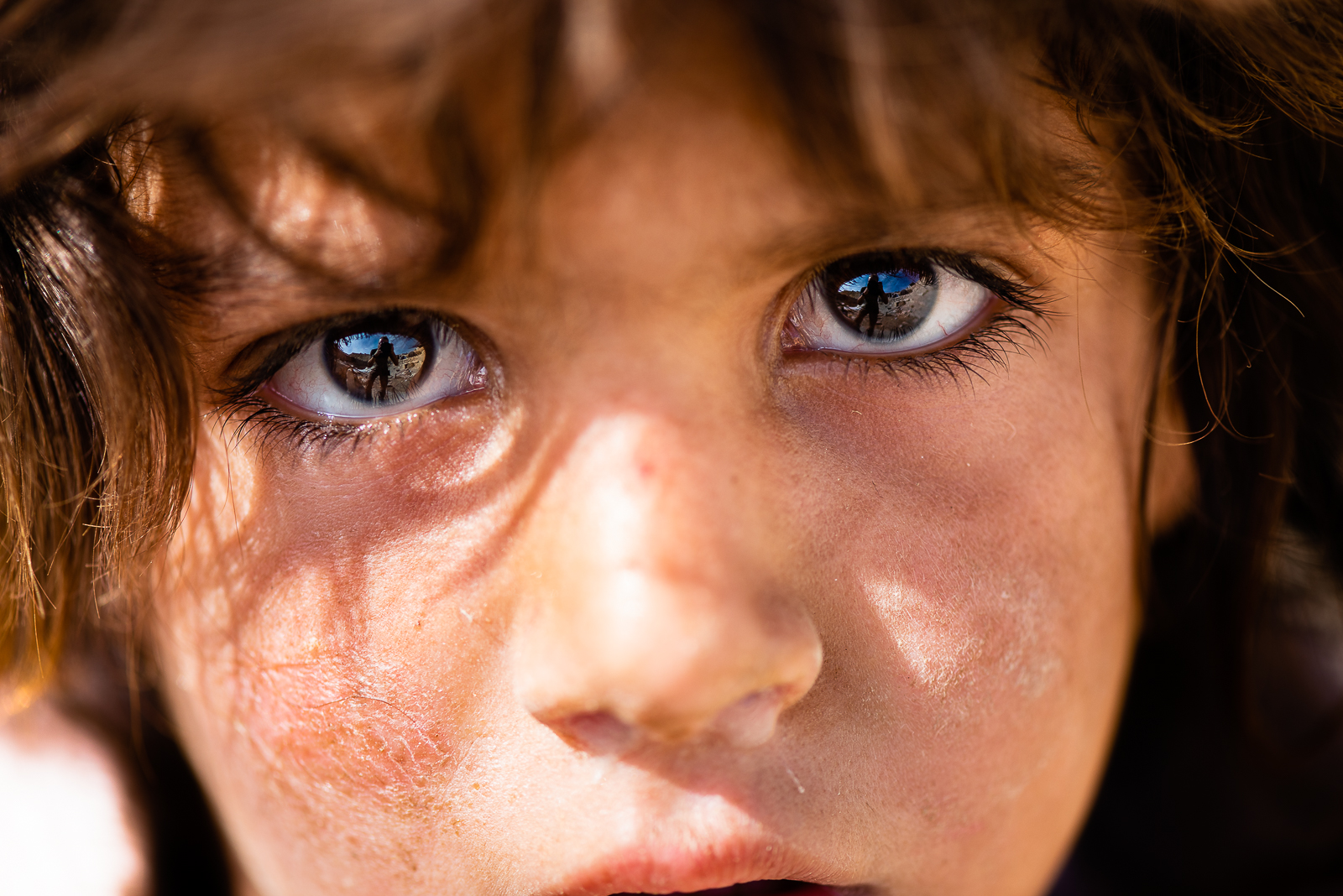 Little boy with the cheeks burned by the sunlight. Mount Sinjar