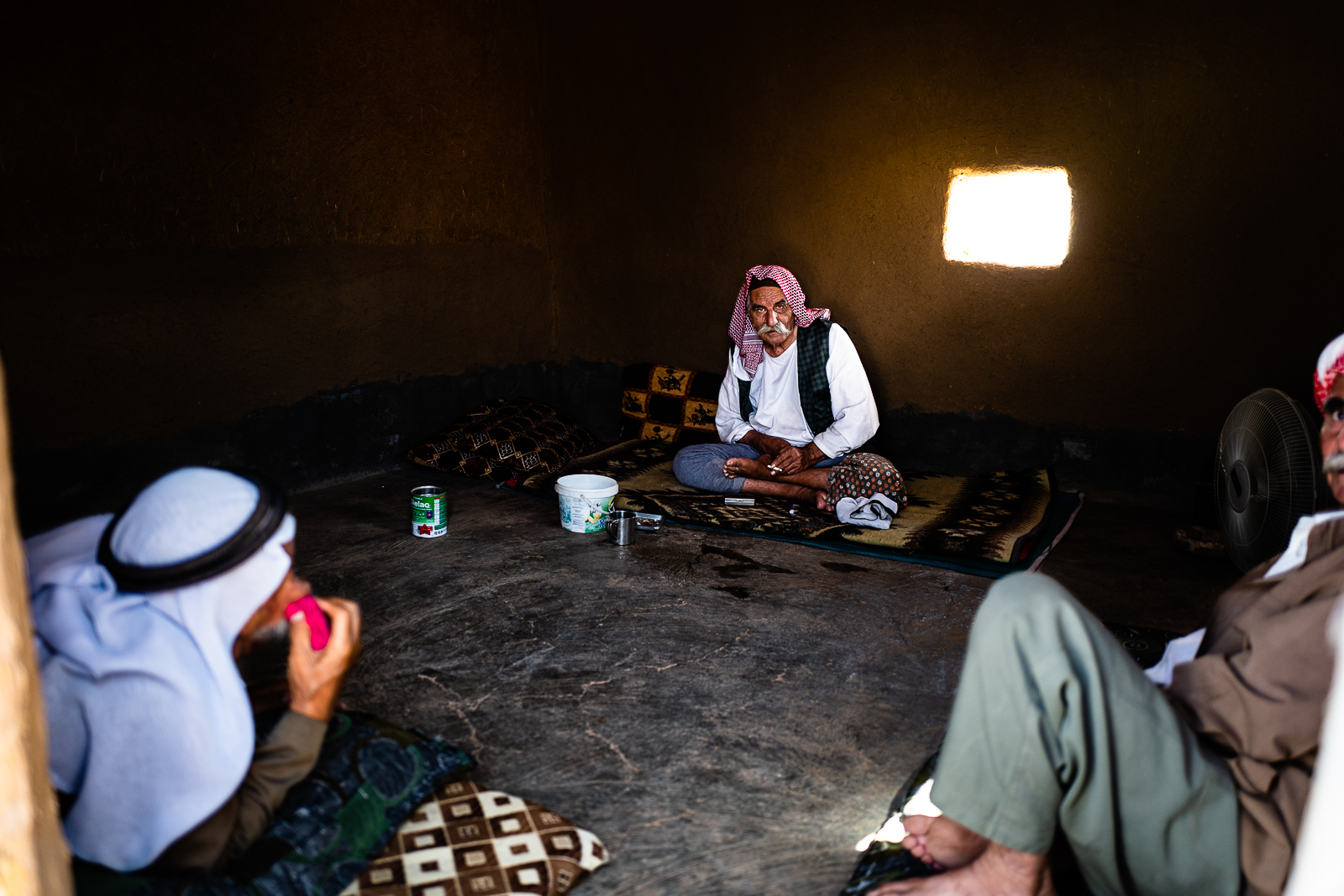 Men are resting in a unofficial camp in Sharya, near Dohuk