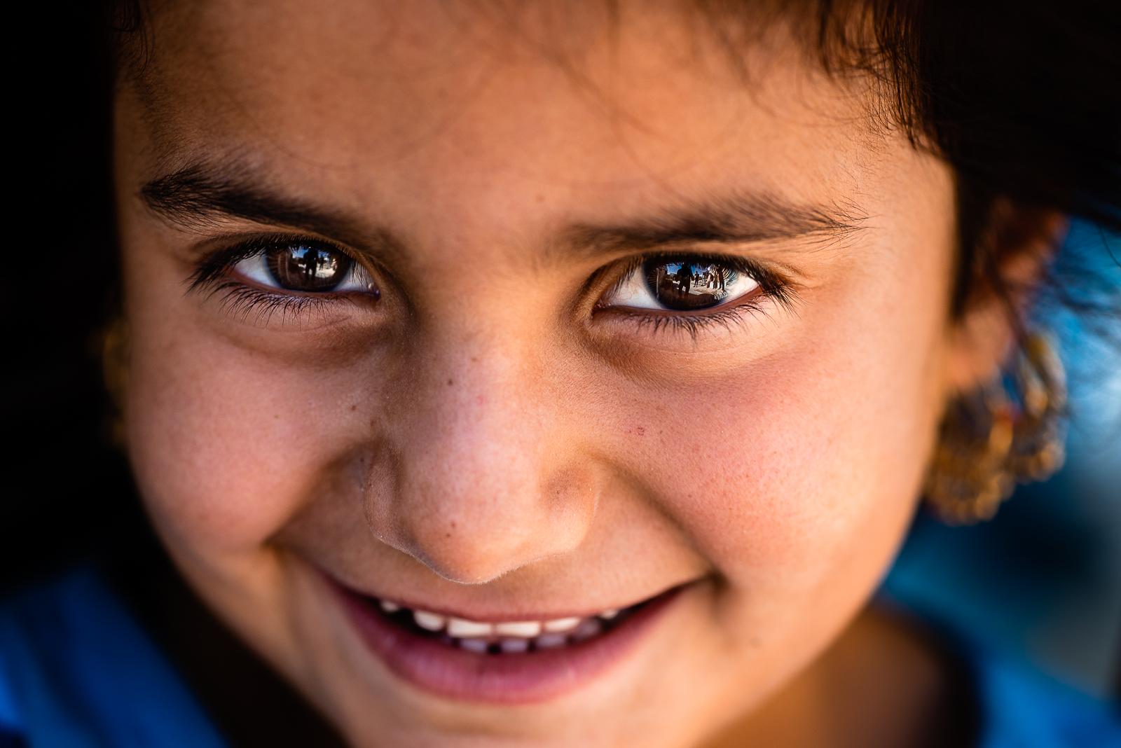 Happy little girl in the refugees camp of Khanik, near Douhk