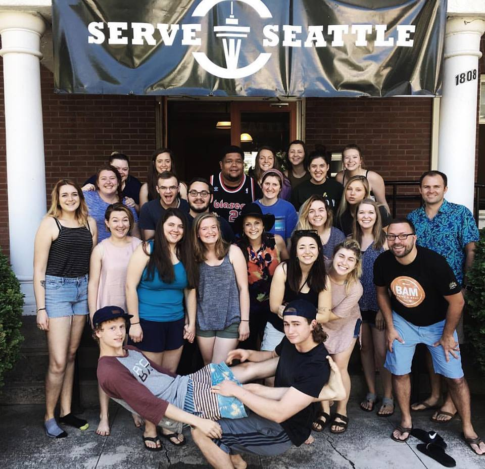 Meet Sam -pictured on the far right in that rad Hawaiian shirt.Sam is one of The Hallows Church original core team and covenant members. In addition to being a sports enthusiast, father of two, and husband to Jess, he's the Director/Founder of Serve Seattle, an urban missions and discipleship program through Seattle's Union Gospel Mission. We asked him to share about the work God is doing in Seattle through the Serve Seattle   program.