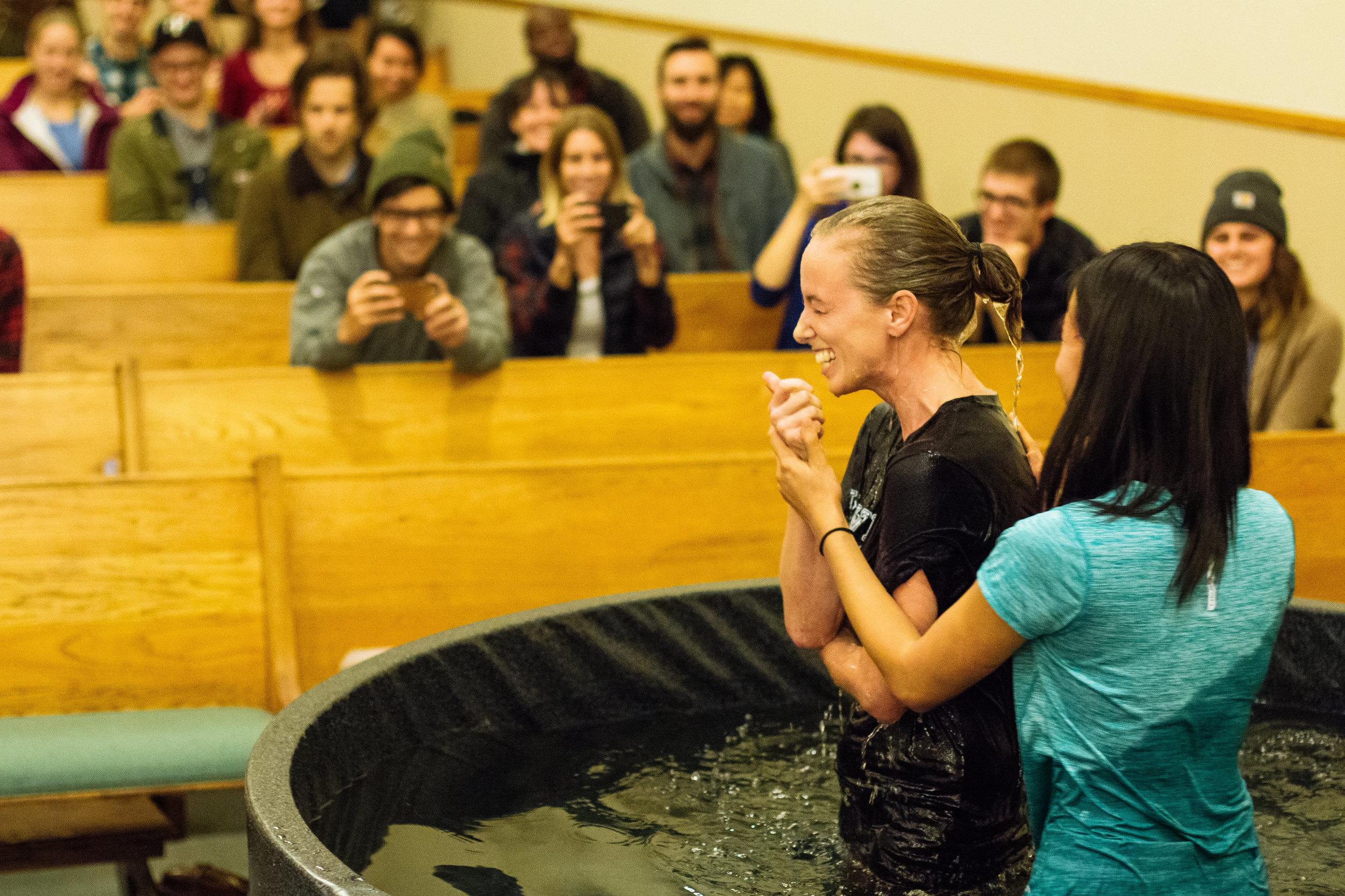 Pictured Above: Sara being baptized by her Missional Community leader, Becky.