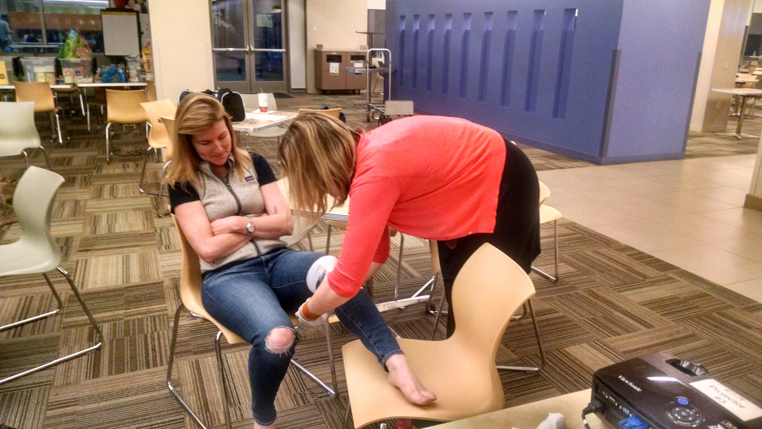 Good times in OEC class - my sister (and fellow patroller) demonstrating a knee bandage on me