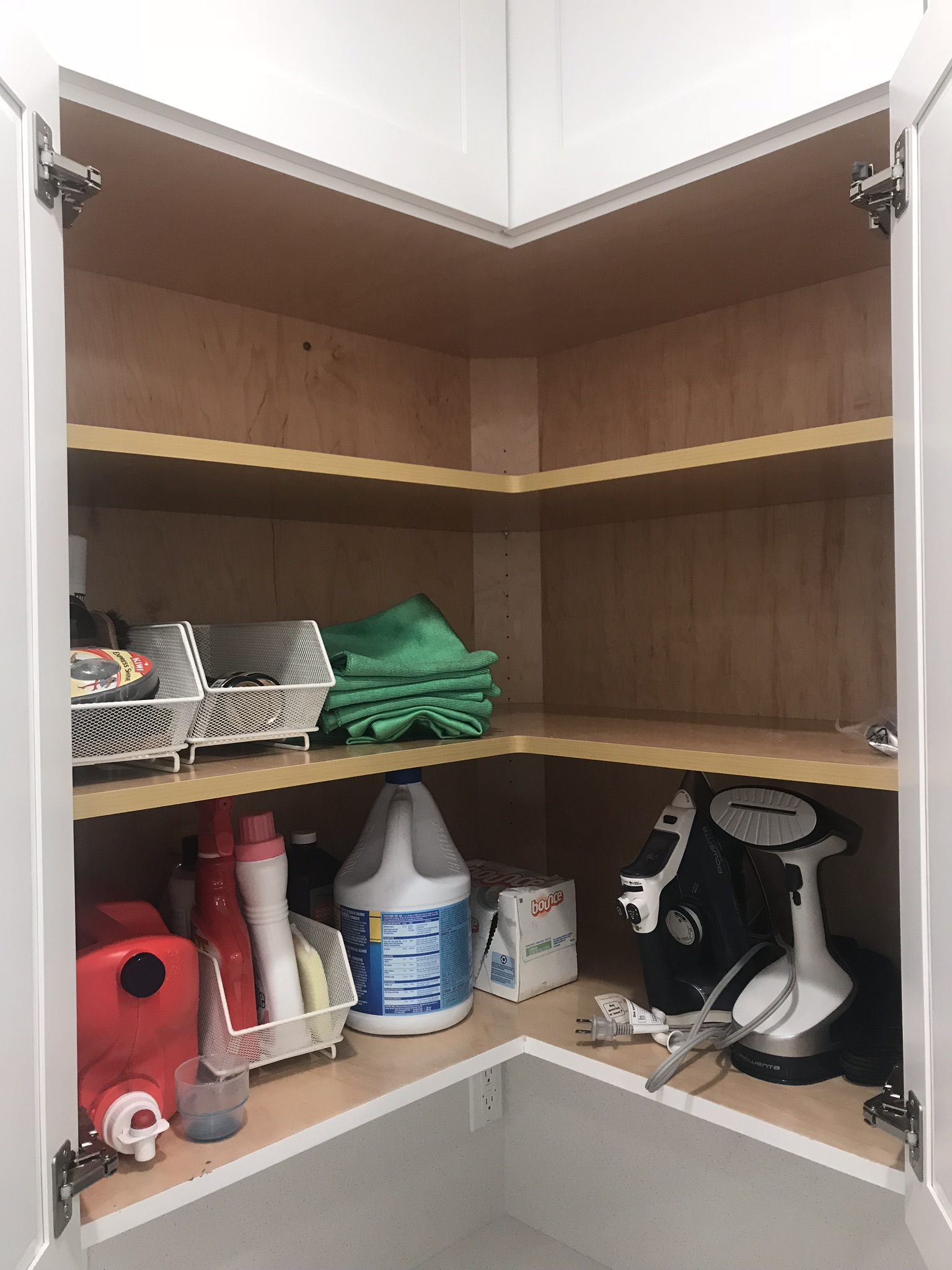 This is our laundry cabinet - everything we need, nothing we don't, and space if needs change. The cabinets above are empty, too!