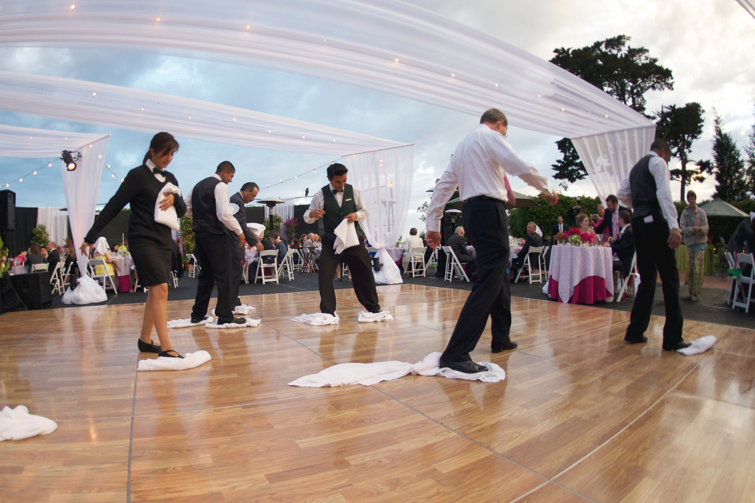 It did, in fact, rain on our wedding day! My planner had the staff (enthusiastically assisted by my dad) out there cleaning off the dance floor plus a backup plan in place, and it became a funny story to tell instead of a disaster.