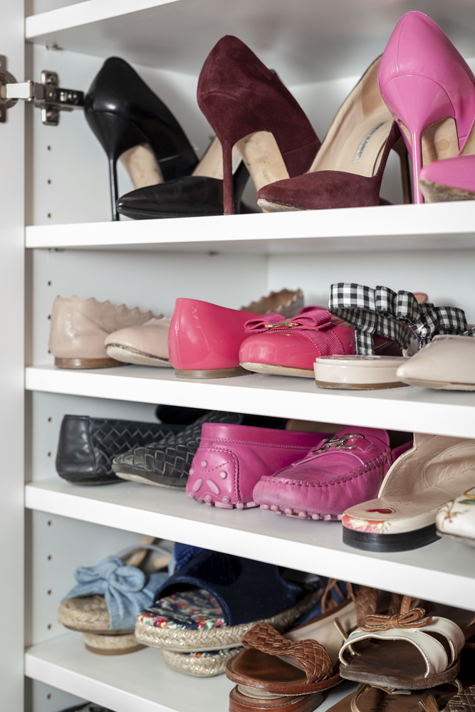Pro tip: arranging pairs of shoes toe-to-heel is the best way to get more shoes on one shelf.
