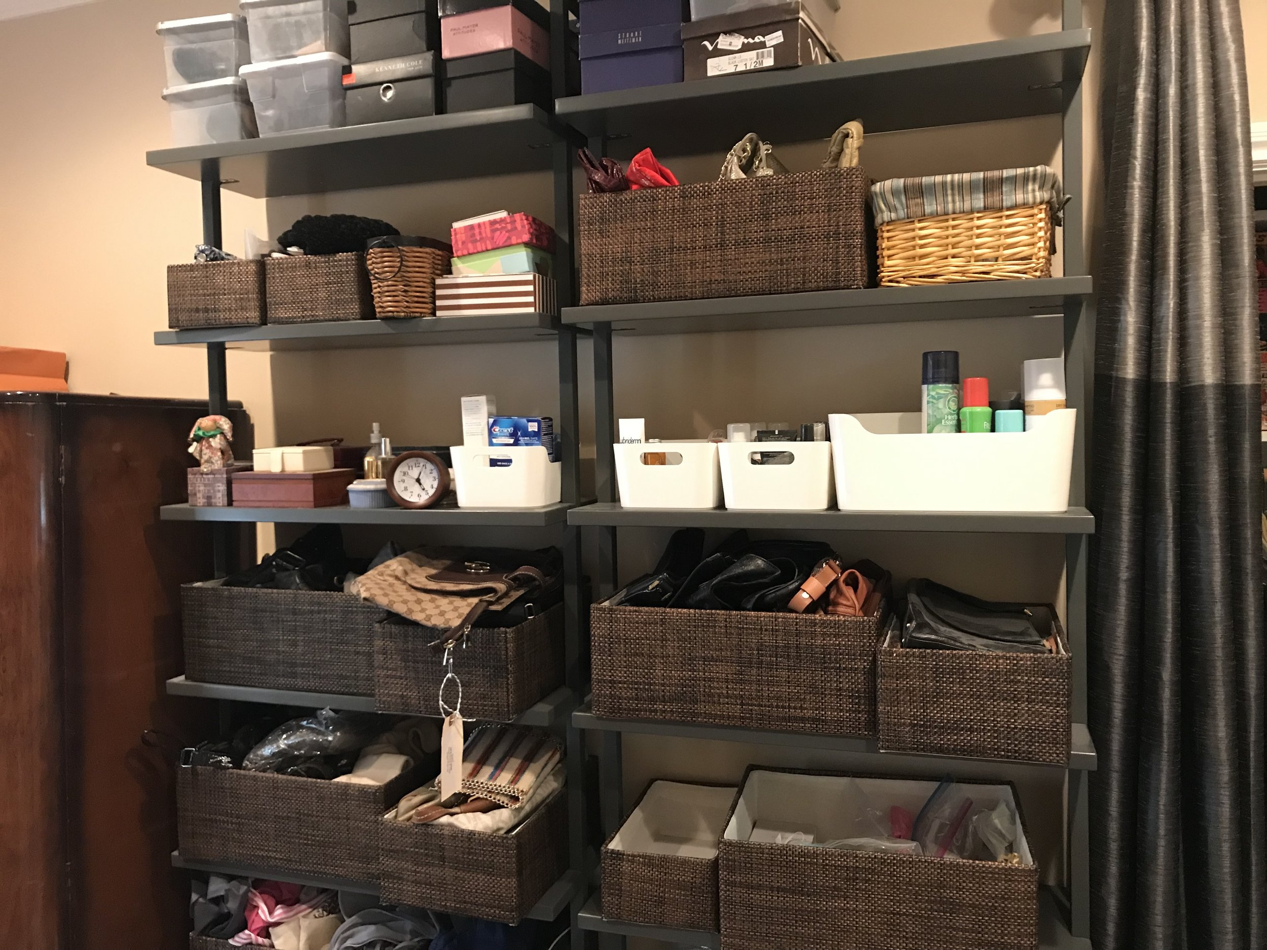 This space is containerized, but not organized. At this point, the client and I still needed to edit her items and store like with like in containers that made sense to her.