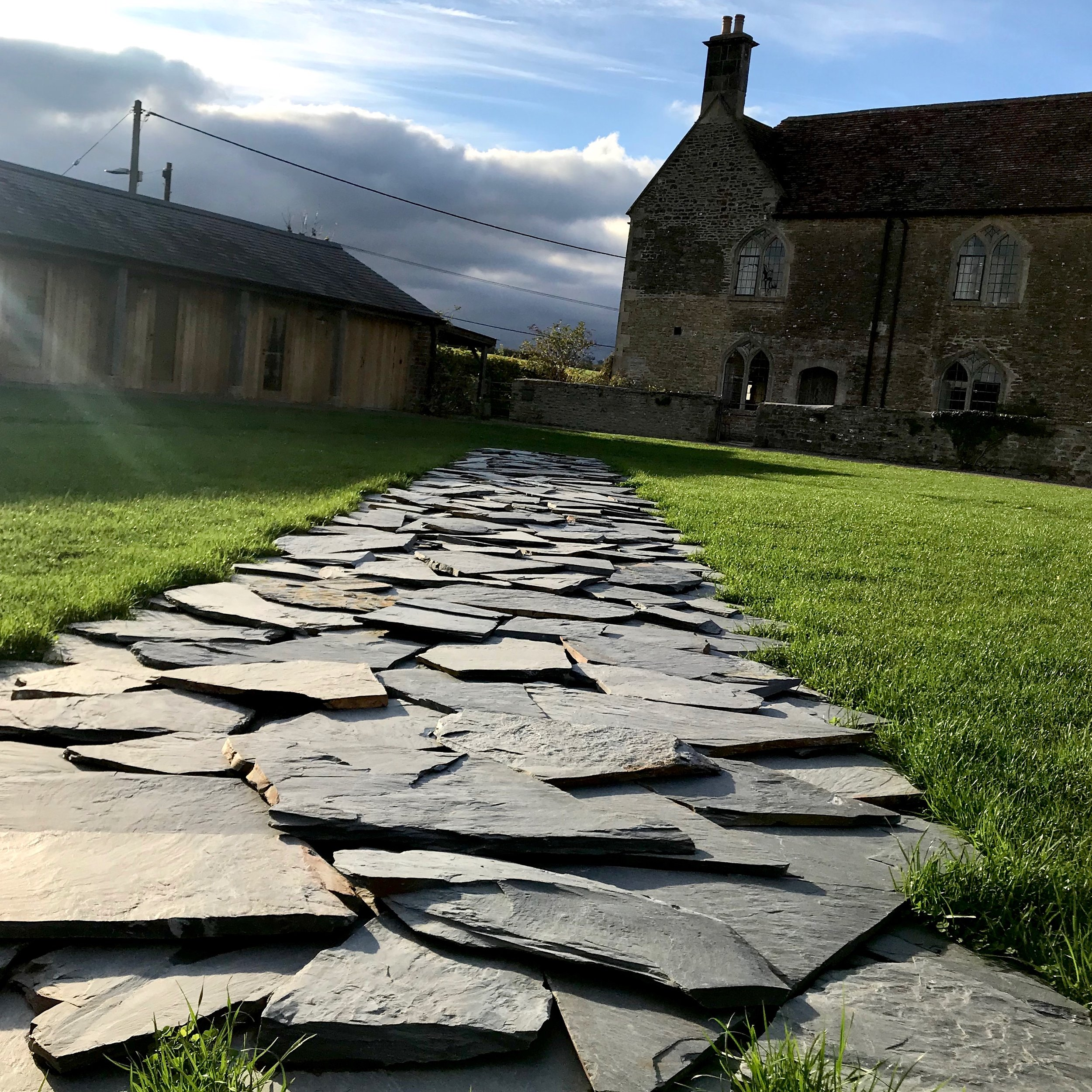 "Richard Long's ""Madrid Line North, 1985"" in the lawn of  Hauser & Wirth's Durslade Farm, Somerset."
