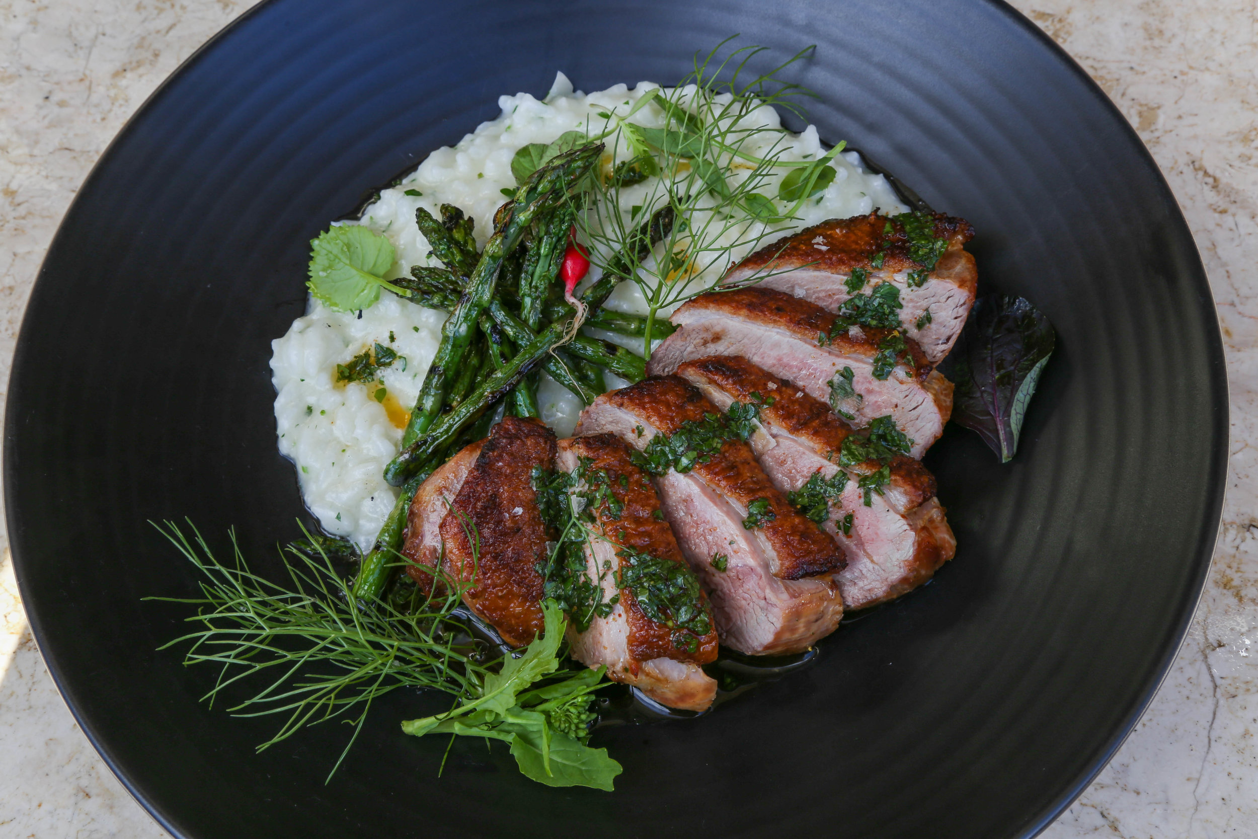 SEARED DUCK BREAST on a recent Sunday Supper in The Gallery, with citrus risotto, pickled chicory, roasted asparagus, fresh garden herbs.