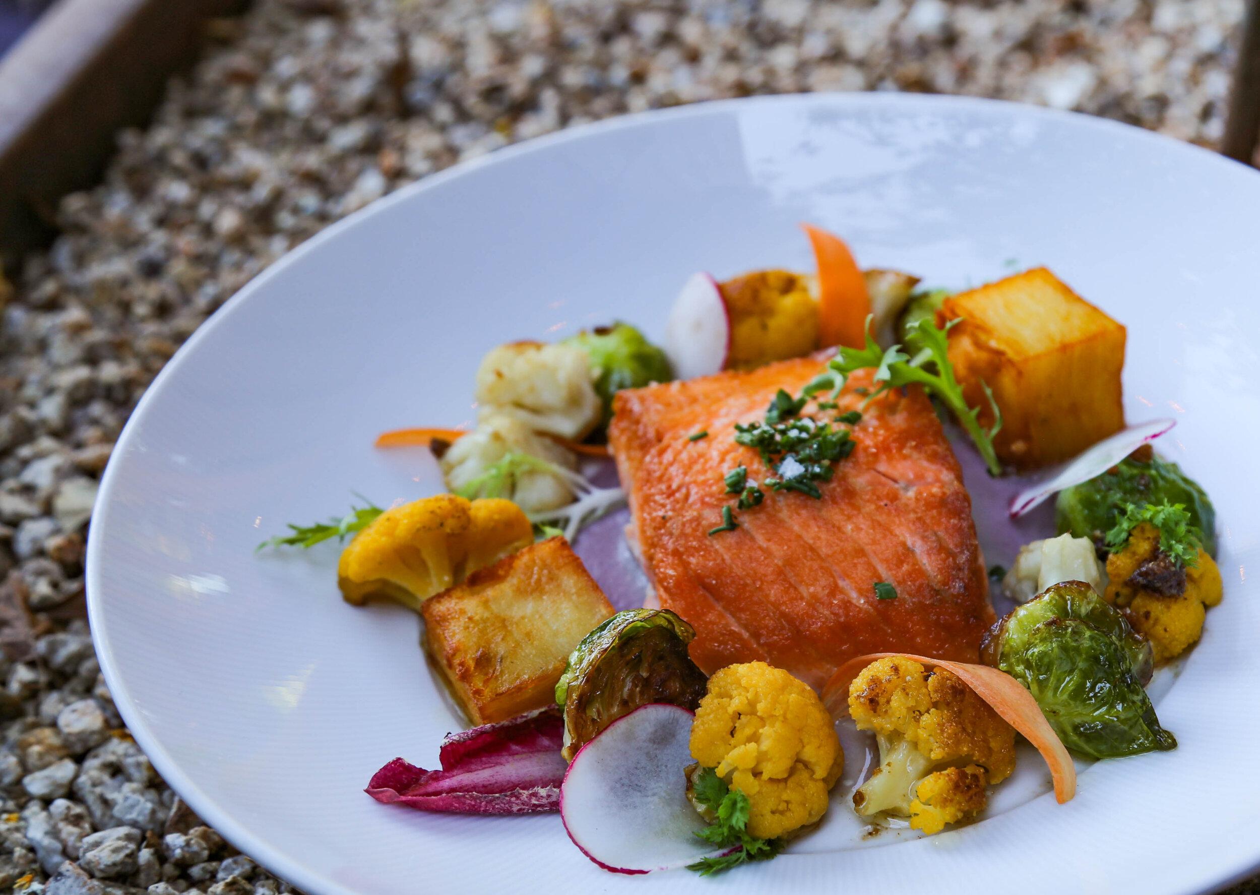 Pan seared salmon, roasted thinly layered sweet potato, orange cauliflower, red wine soubise