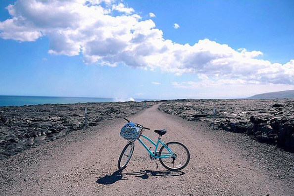 Biking alongside acres and acres of lava ruins... and the smoke behind my bike? That's fresh lava still pouring into the ocean. Hawai'i is too cool 🌋   |   Hawaii