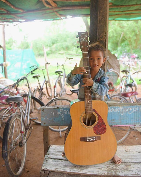 "You've got more in common with people in these ""foreign"" countries than you'd think. Go get to know them and surprise yourself. Charat - my new best friend here in Cambodia - wears a Clemson patch on his dusty, torn jean shirt and loves bicycles and guitar. 