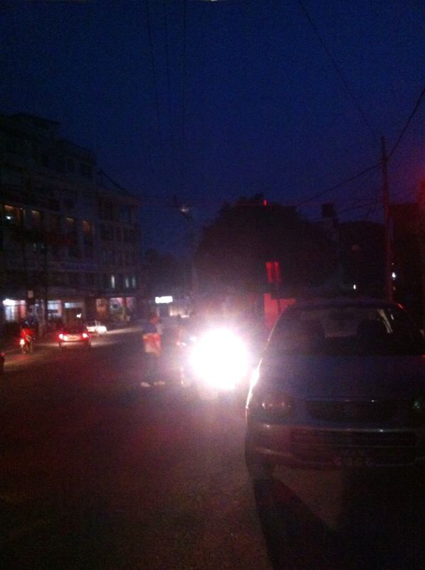 Exchanging luggage in the dark streets of Kathmandu