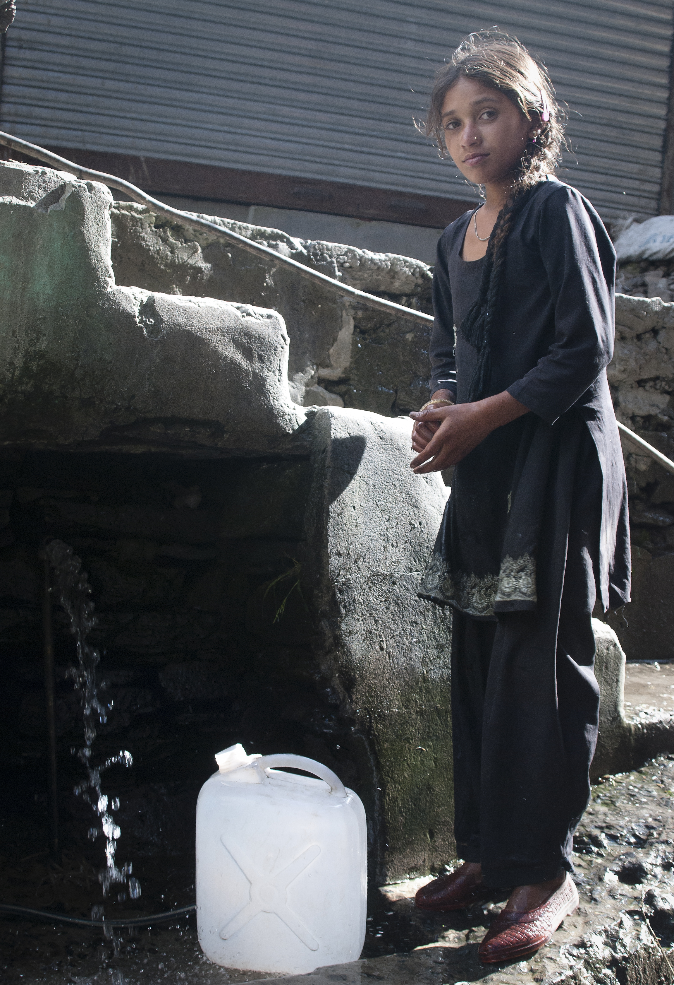 A young girl from the village collects water for her family.