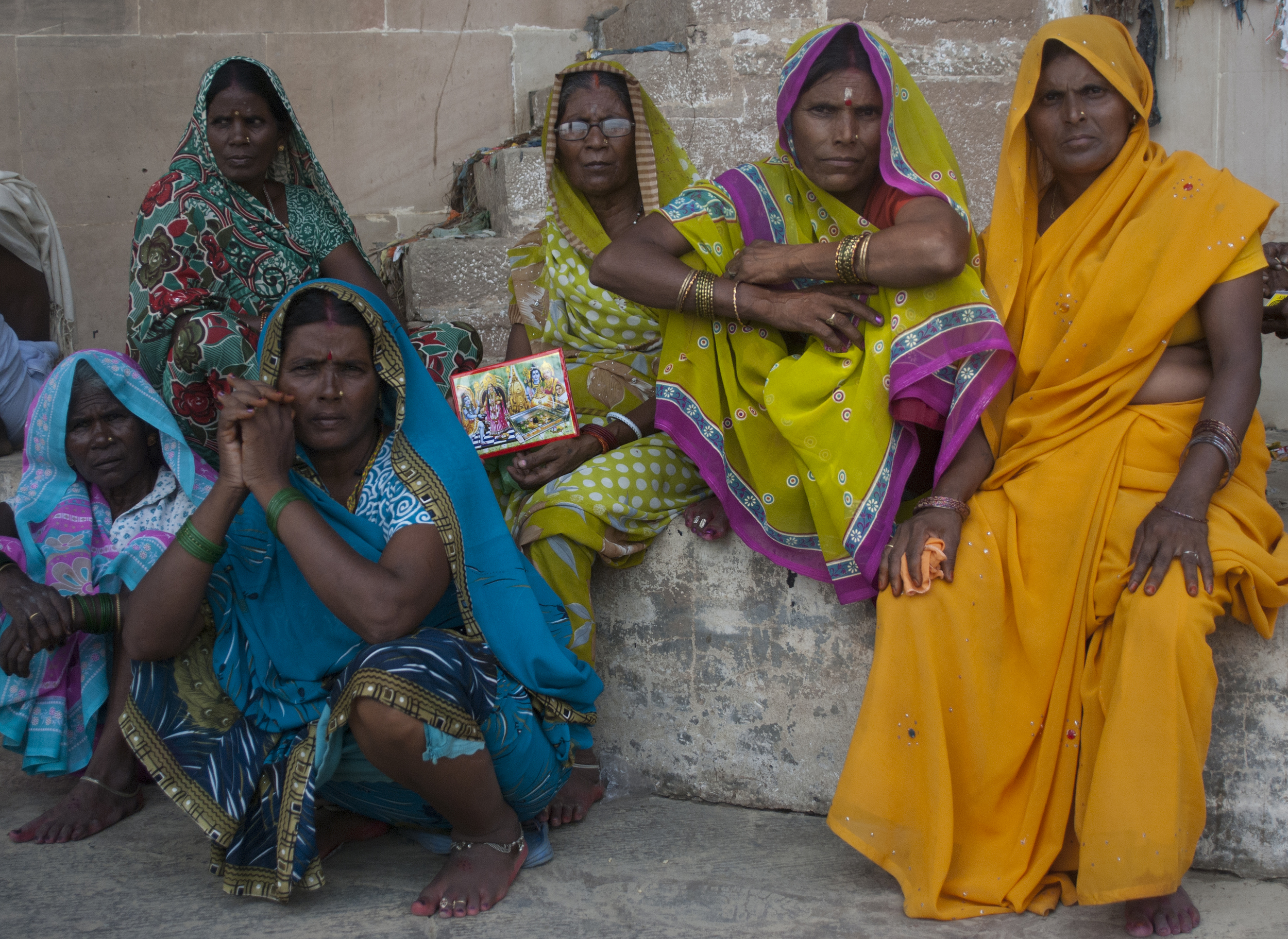 Varanasi women perch on a staircase outside of the burning ghats in Varanasi.