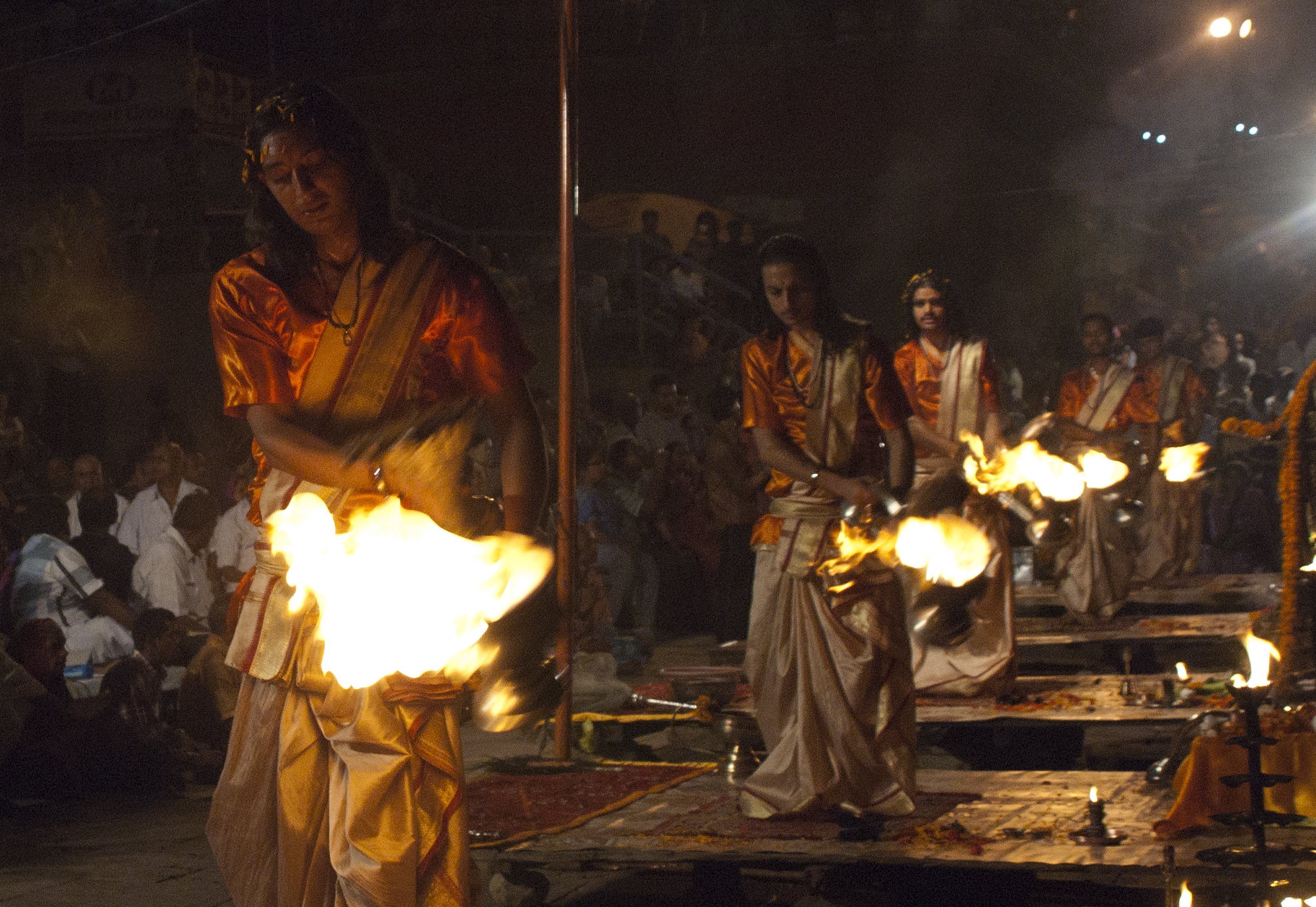 Fire dancers perform in the nightly ceremony along the Ganges.
