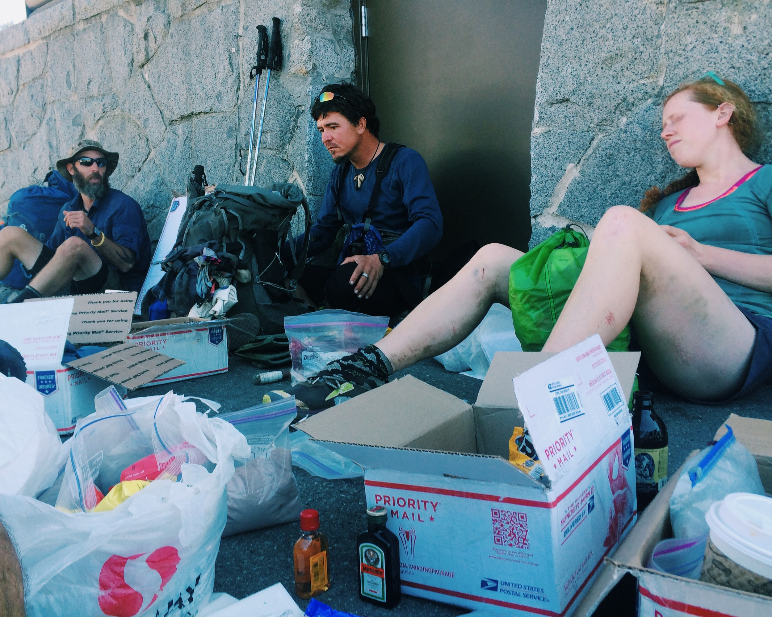 Hiker trash hanging out, going through resupply boxes in Snoqualmie Pass. (Smokes, Trail Dancer and Frizzle)