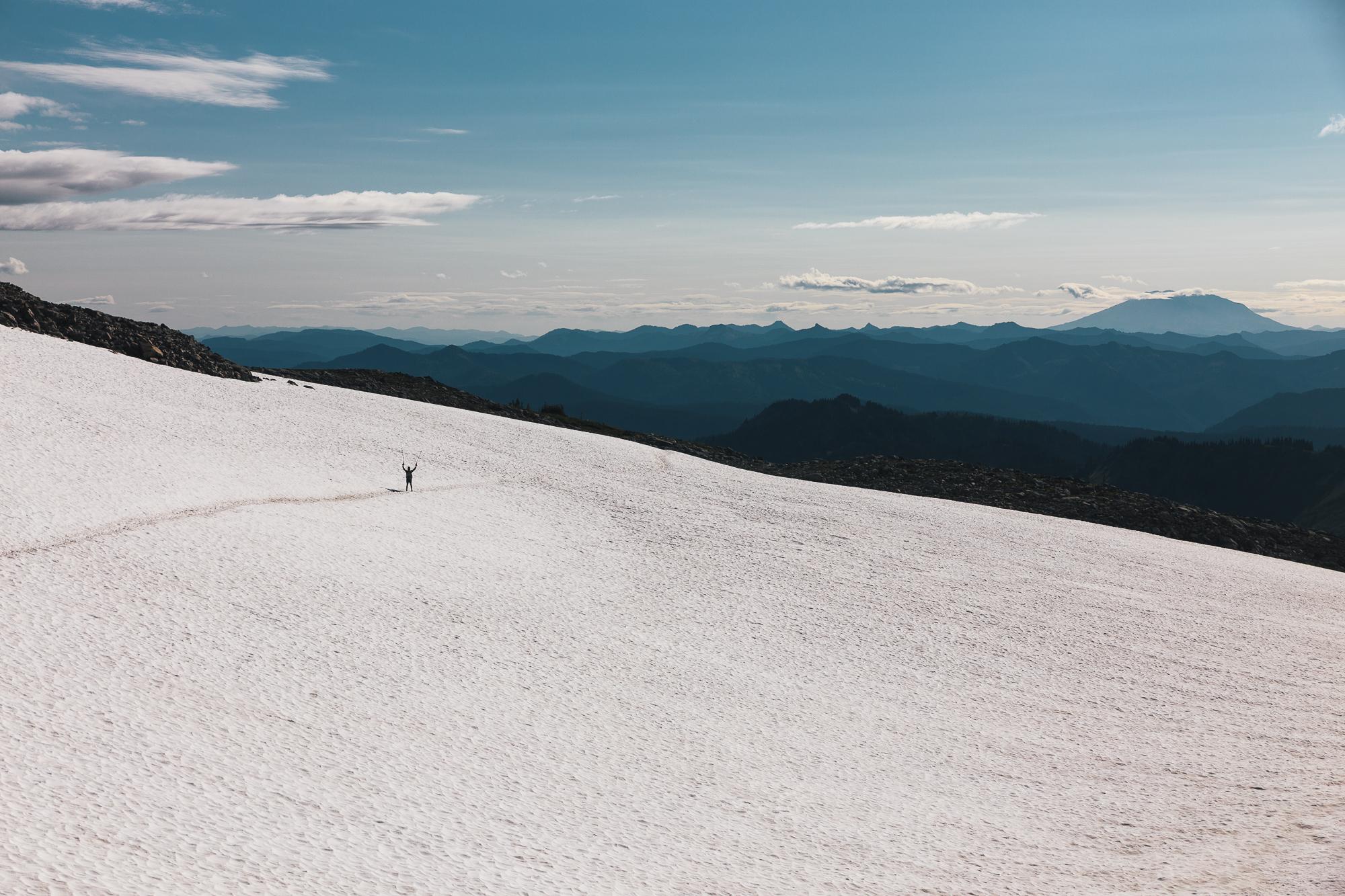 Smitty traversing a snowfield in Goat Rocks.