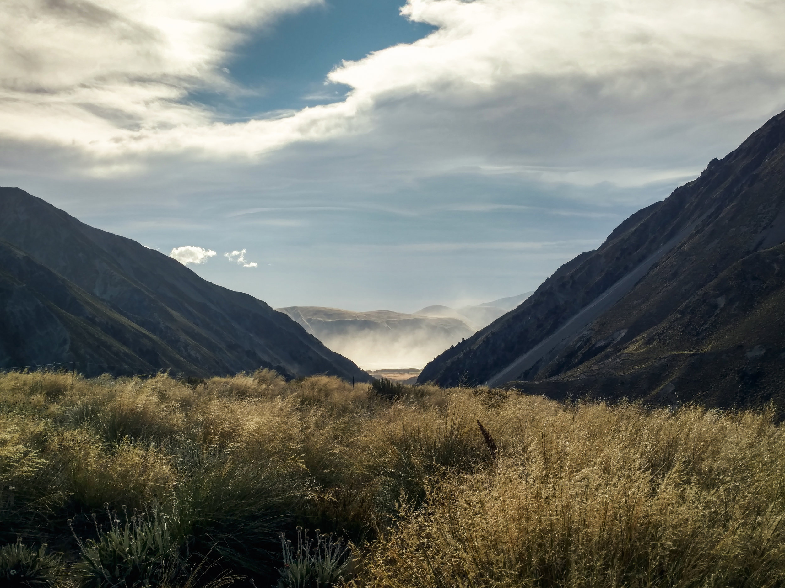 Looking back down at the dust storm still raging in the valley below made us glad to be past the Rangitata.  photo/ Molly