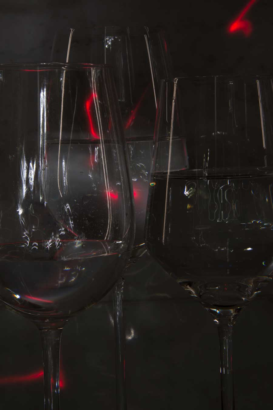Light Painted Glassware© Naida Ginnane 2018, Nikon D800, 24-70mm lens.   Wine glasses with different levels of water. I left the door of my dark space open a fraction to create the long lines of light on the sides of the glasses. The rest was achieved with my torch and a tiny spot of laser light.