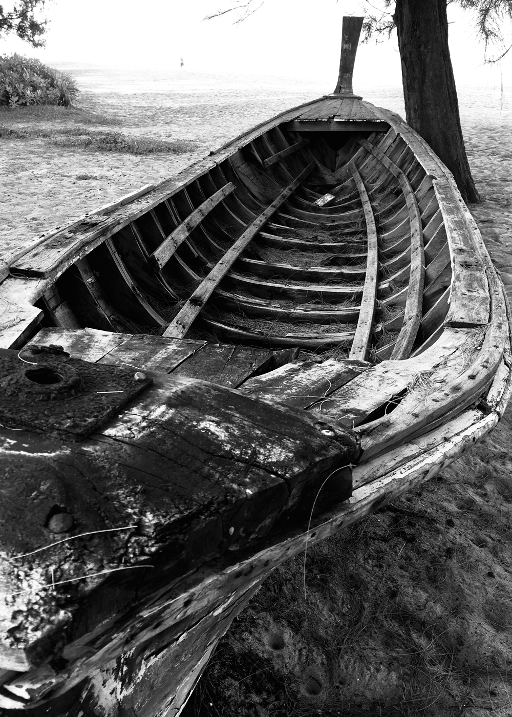 Boat © Naida Ginnane 2018, iPhone 6, Camera on 'Noir' setting.  This scene really lent itself to be shot in black and white. The texture on the boat and sand combined with the shape is enough to create a compelling image without colour.