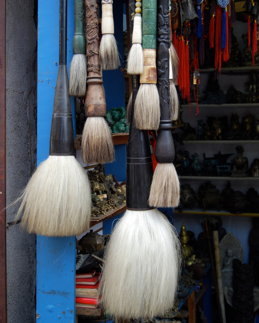'Calligraphy Brushes' © Naida Ginnane 2008 Nikon D40X, 38mm lens, f/4.8, 1/100, ISO 200  A collection of horse hair calligraphy brushes in a Beijing market. Grouping the same type of object is a great way to shoot