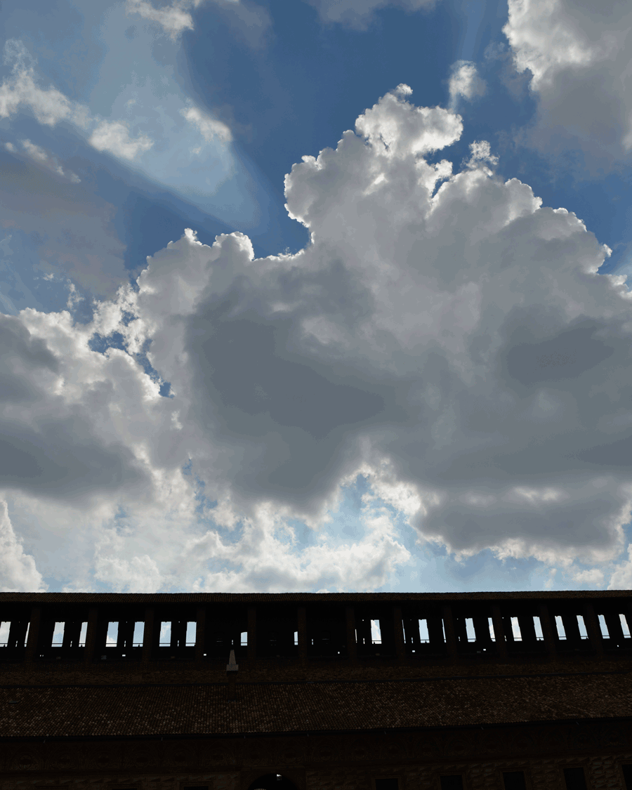 'Walled Sky' © Naida Ginnane 2017 Nikon D800, 24-70mm lens. f/10, 1/800, ISO 100  The silhouette wall works really well as a contrast to the highly detailed, three-dimensional cloud shapes and beams of light in the sky.