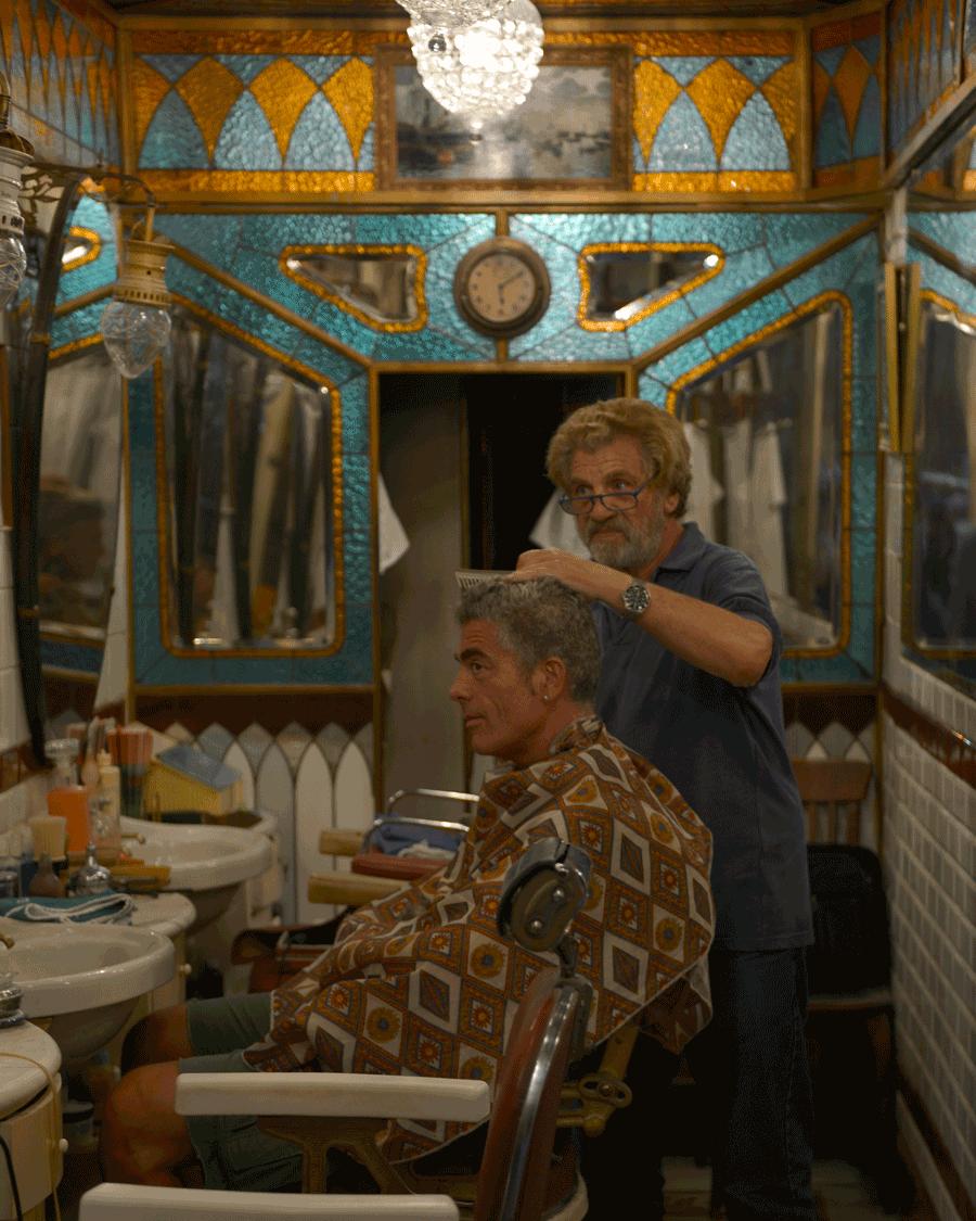 'Haircut' © Naida Ginnane 2016 Nikon D800, 24-70mm lens f/7.1, 1/40, ISO 250  A private moment between barber and client.