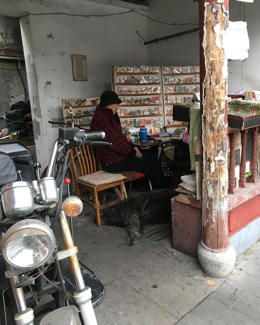 'Man, dog & bike' © Naida Ginnane 2017 iPhone 6. f/2.2, 1/1900, ISO 32  A man sits quietly at his workshop while his dog and motorbike wait patientl