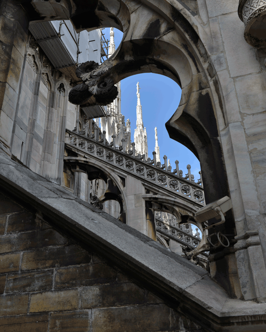 'Gothic Frame' © Naida Ginnane 2013 Nikon D800, 24-70mm lens. f/6.3, 1/400, ISO 125  The dark, earthy tones of the stone contrast sharply with the bright blue sky and the white spires.