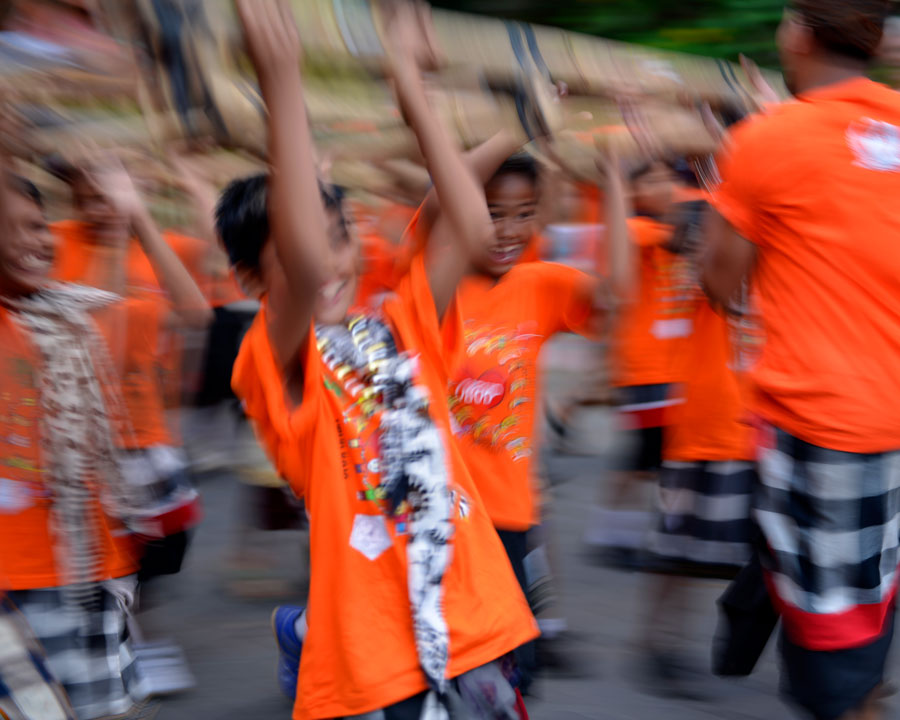 'Nyepi lads' © Naida Ginnane 2015 Nikon D800, 24-70mm lens. f/2.8, 1/13, ISO 100  I love the way the blur in this shot captures the boys' movement as well as the sheer joy on their faces.
