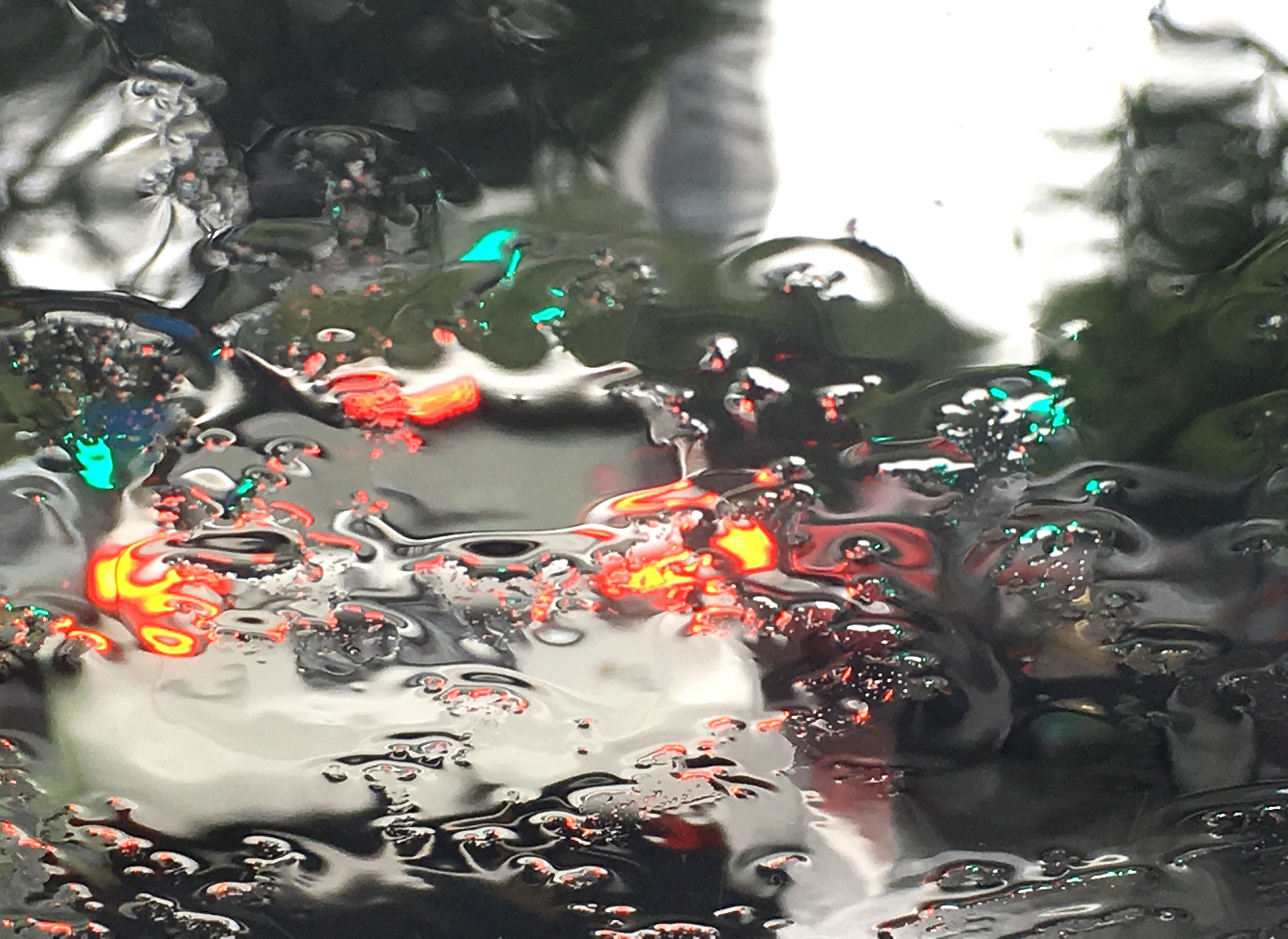 WEEK 2: Rain. 'Through The Rain' © Naida Ginnane 2018, iPhone 6s. This one was oodles of fun to shoot- apart from the fact that I was driving at the time- stopped at the lights, with the wipers off to capture the water patterns on the windscreen.
