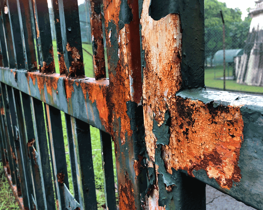 'Gates' © Naida Ginnane 2018, iPhone X, Camera + App 1/ 700, f/1.8, ISO 20. The rust colouring contrasts beautifully with the original paint colour of these gates.
