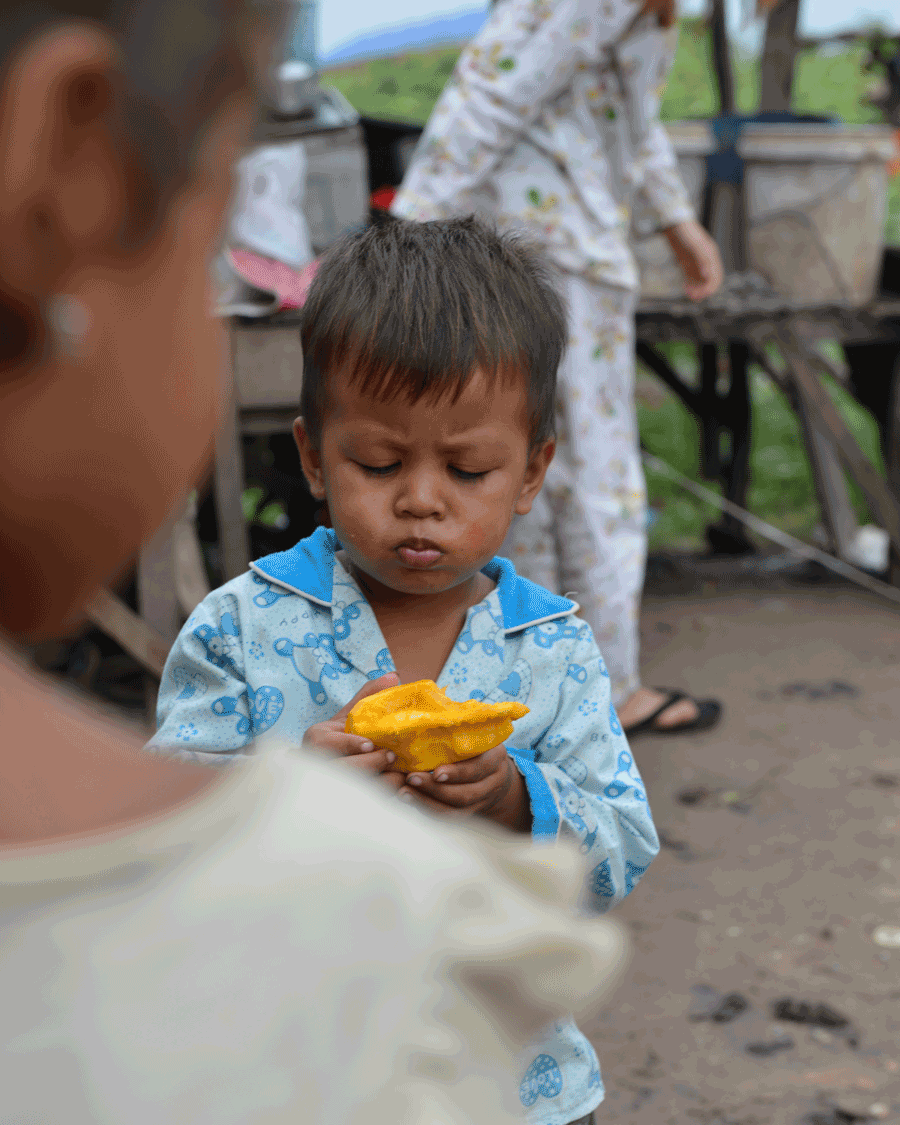 'Mango Treat' © Naida Ginnane 2016 Nikon D800 24-70mm lens, 1/160 f/7.1 ISO 100. This image of a boy eating mango is a great example of a narrow depth of field because only the middle ground is in focus. DOF is very useful device to draw your viewer's attention to the most important part of your image.