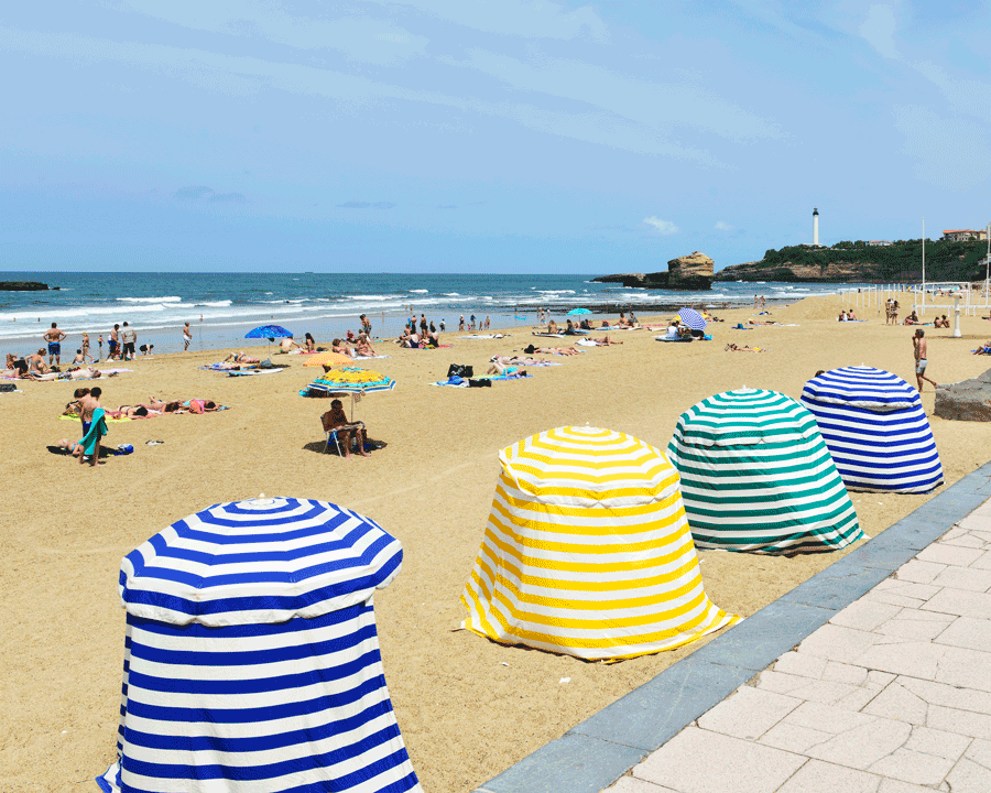 'On the Beach' © Naida Ginnane 2015 Nikon D800 24-70mm lens,1/ 250, f/11.0, ISO 100. The placement of these striped beach huts at regular intervals creates an interesting diagonal rhythm.