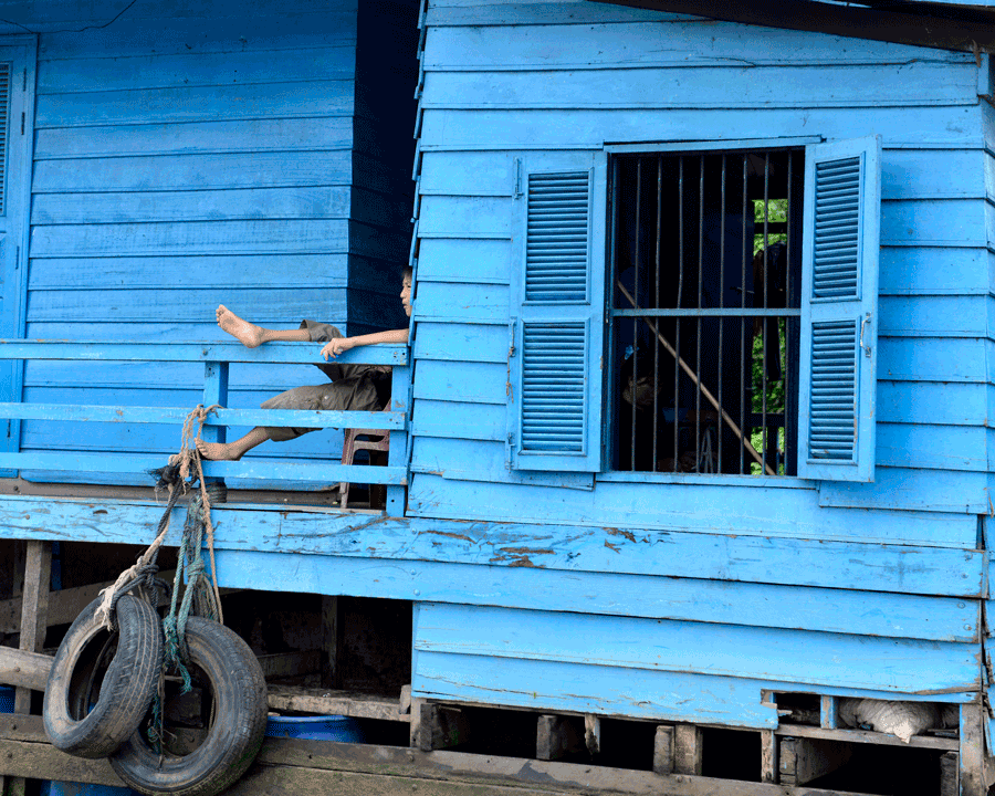 'Blue Afternoon' © Naida Ginnane 2015 Nikon D800 24-70mm lens,1/100, f/5, ISO 100. The blue house fills the frame and gives us a closer look at one of it's occupants.