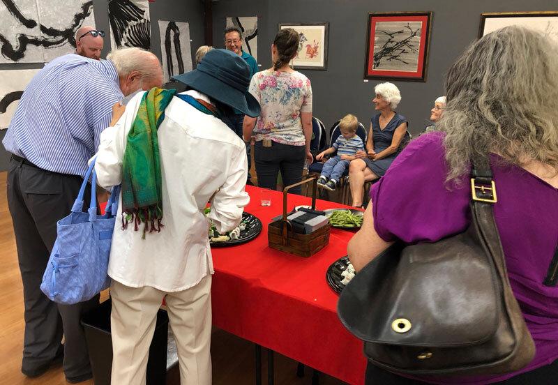 Exhibit guests at the Kohnami food tables.