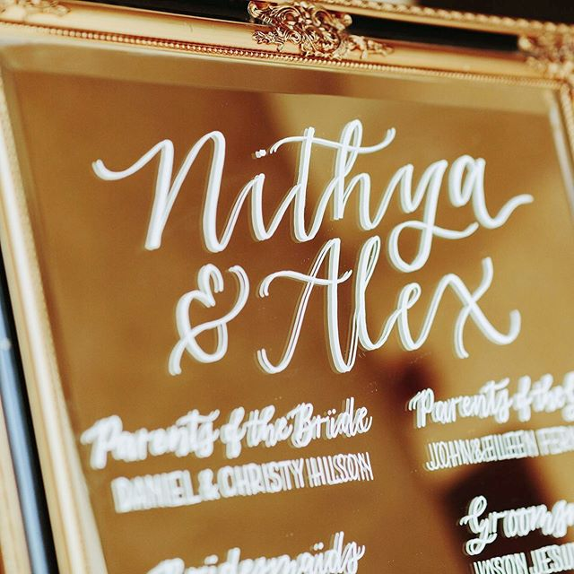 Close-up of N+A's wedding party program on this grand, antique mirror ✨ . Photography: @hilaurenhello