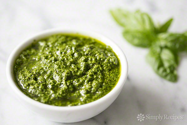 Fresh Basil Pesto - Ingredients:2 cups fresh basil leaves, packed (can sub half the basil leaves with baby spinach)1/2 cup freshly grated Romano or Parmesan-Reggiano cheese (about 2 ounces)1/2 cup extra virgin olive oil1/3 cup pine nuts (can sub chopped walnuts)3 garlic cloves, minced (about 3 teaspoons)1/4 teaspoon salt, more to taste1/8 teaspoon freshly ground black pepper, more to tasteDirections:Pulse basil and pine nuts in a food processor: Place the basil leaves and pine nuts into the bowl of a food processor and pulse a several times.Add the garlic and cheese: Add the garlic and Parmesan or Romano cheese and pulse several times more. Scrape down the sides of the food processor with a rubber spatula.Stream in the olive oil: While the food processor is running, slowly add the olive oil in a steady small stream. Adding the olive oil slowly, while the processor is running, will help it emulsify and help keep the olive oil from separating. Occasionally stop to scrape down the sides of the food processor.Stir in salt and freshly ground black pepper, add more to taste.Toss with pasta for a quick sauce, dollop over baked potatoes, or spread onto crackers or toasted slices of bread.simplyrecipes.com