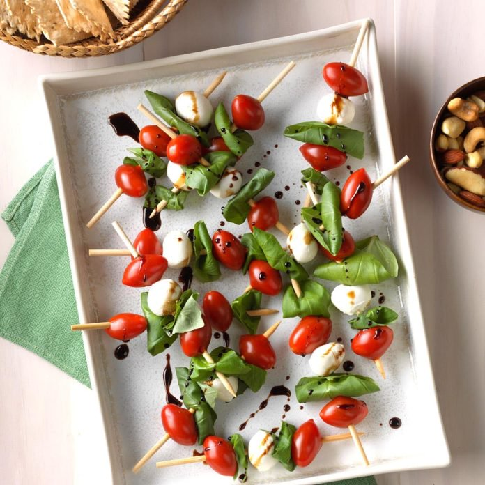 Caprese Salad Kabobs - Ingredients:24 grape tomatoes12 cherry-size fresh mozzarella cheese balls24 fresh basil leaves2 tablespoons olive oil2 teaspoons balsamic vinegarDirections:On each of 12 appetizer skewers, alternately thread two tomatoes, one cheese ball and two basil leaves. To serve, whisk together oil and vinegar; drizzle over kabobs.tasteofhome.com