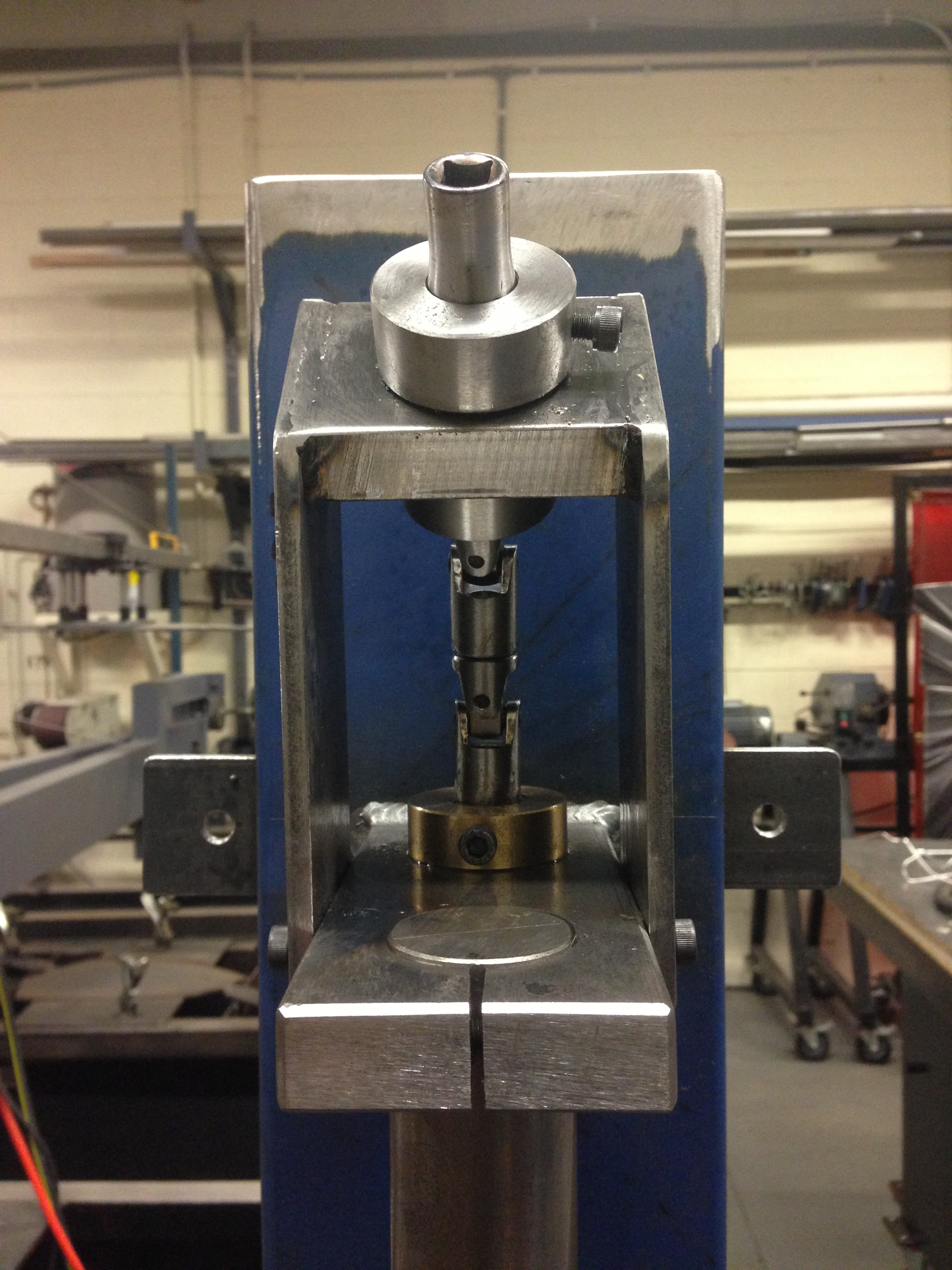 CLOSE UP OF HEIGHT ADJUSTMENT FOR GLASS GRINDING MACHINE
