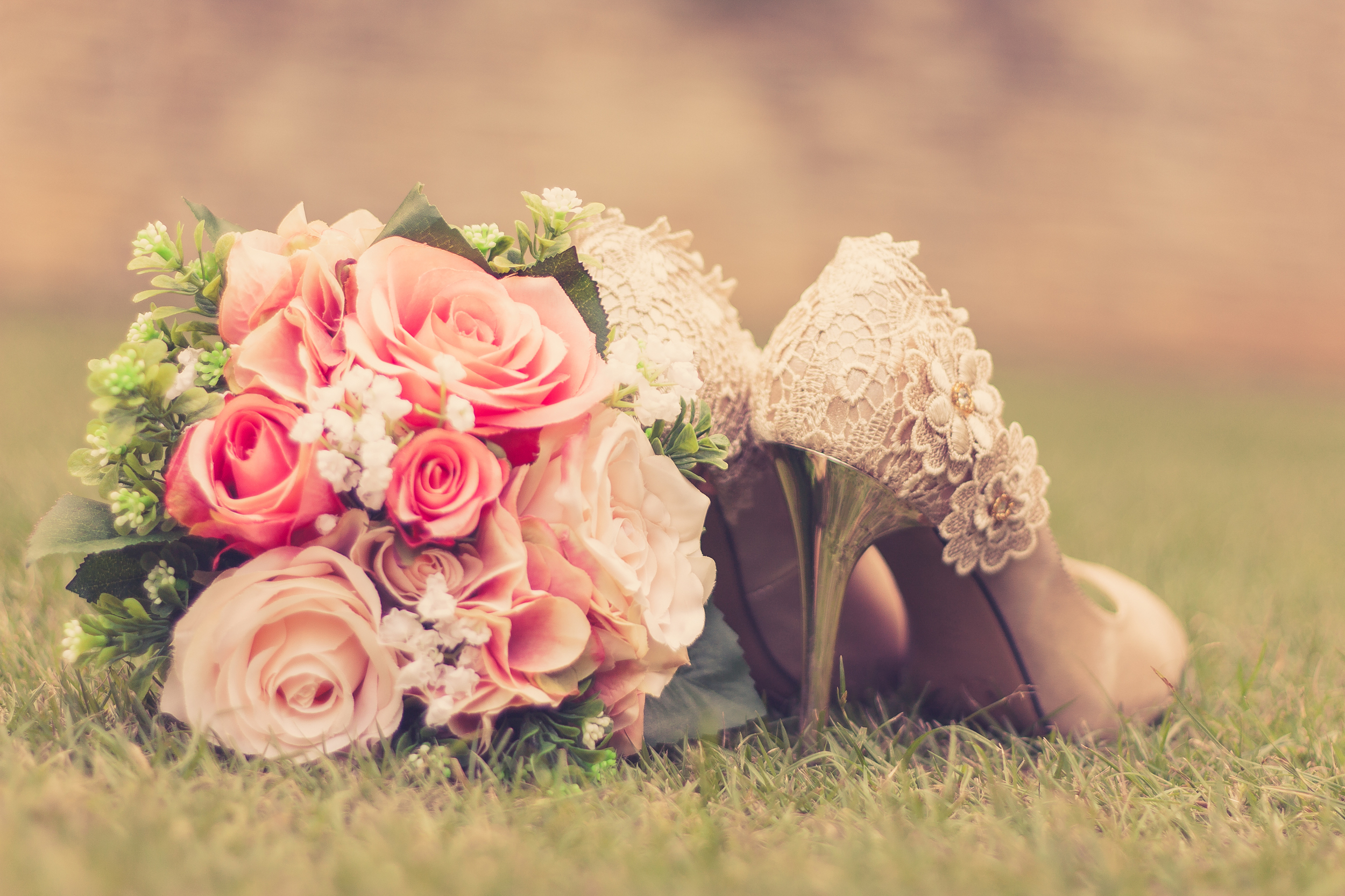 Brides lovely shoes and bouquet