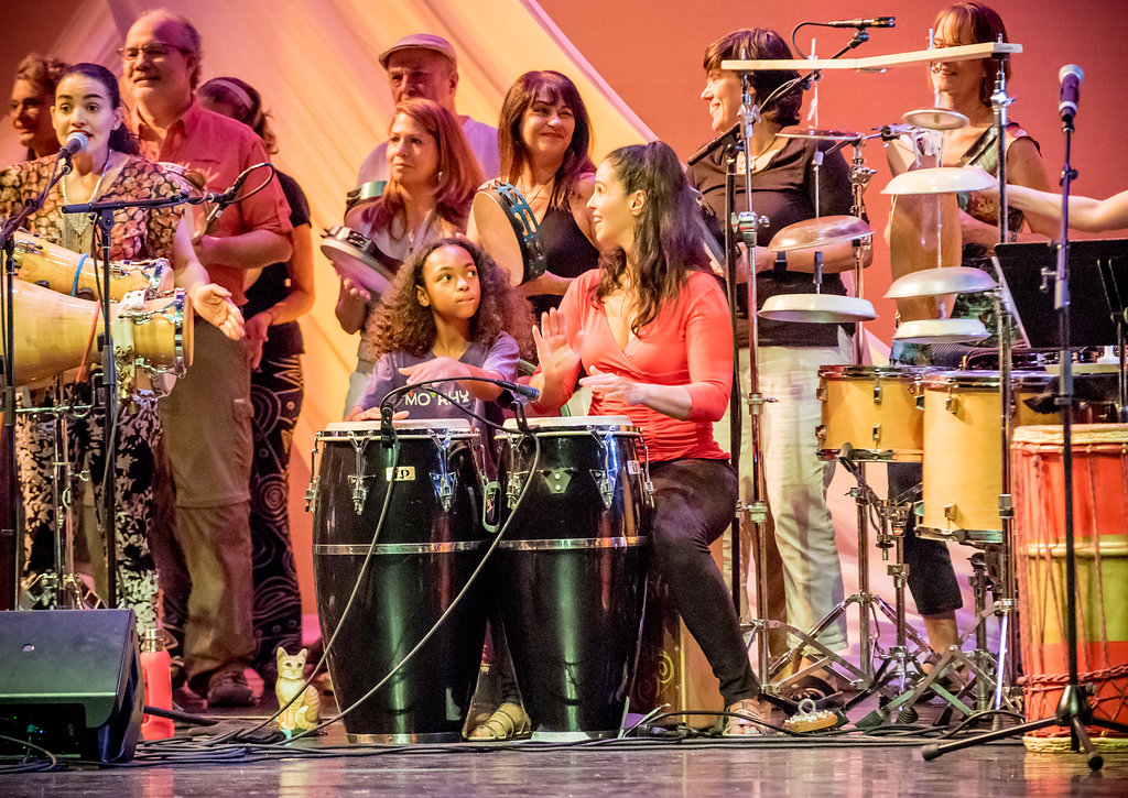 Lisette Santiago, Nasira Keita, and Monette Marino with Participants from the Advanced Track of the Intensive Program, in the finale piece of the Masters of Percussion Concert