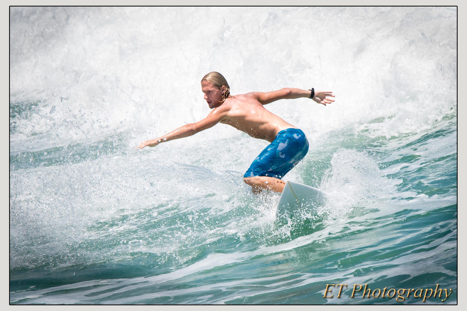 I never photographed someone surfing before but couldn't resist while watching a group of teens hitting the waves.