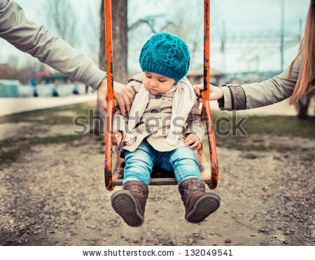 stock-photo-sad-child-on-a-swing-in-between-her-divorced-parents-holding-her-separately-132049541.jpg