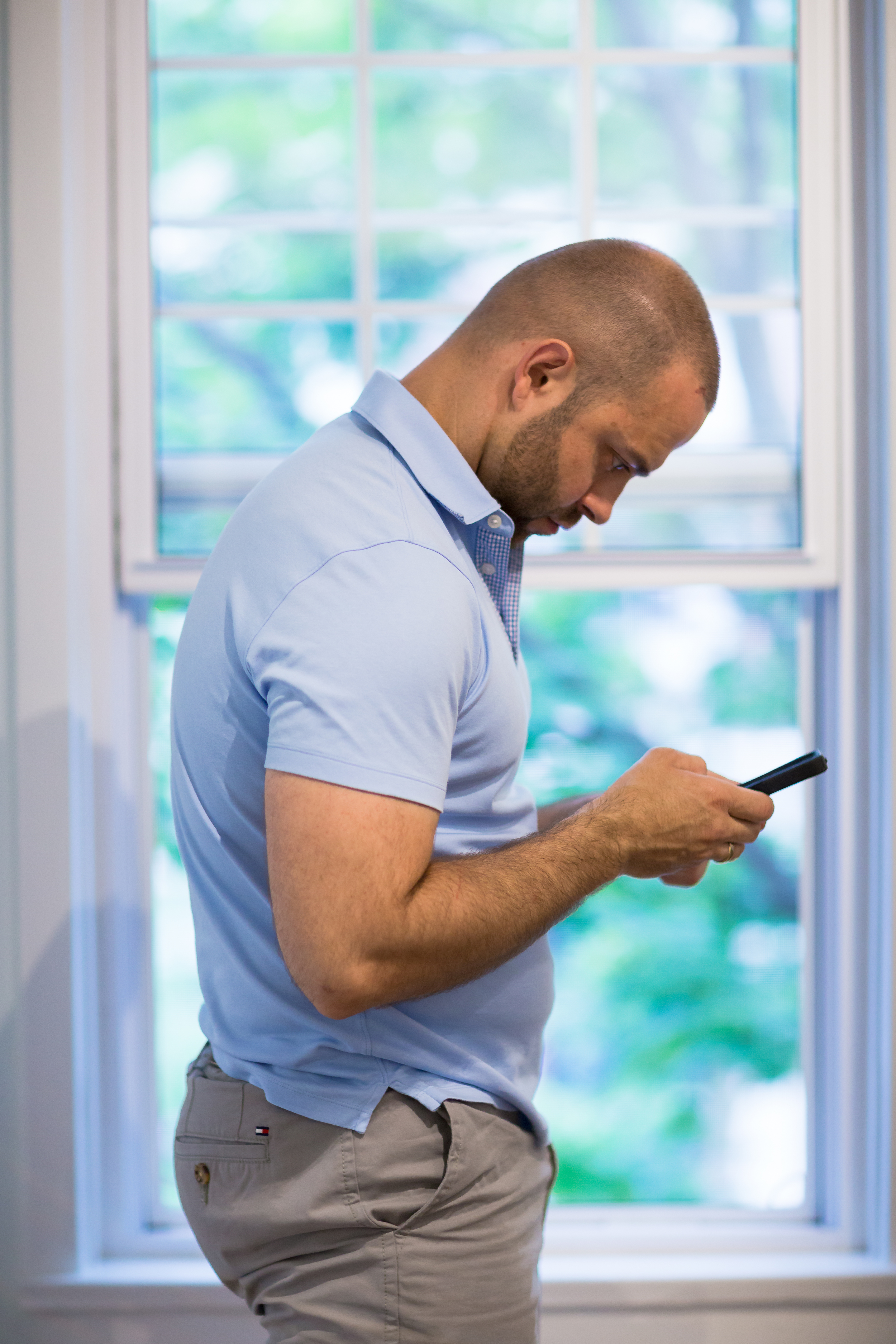 DON'T:  Using your mobile phone while standing, the same applies as when at your desk. It will place strain on your neck, shoulder, lower back, abdomen and eyes. All of which I don't think you want.