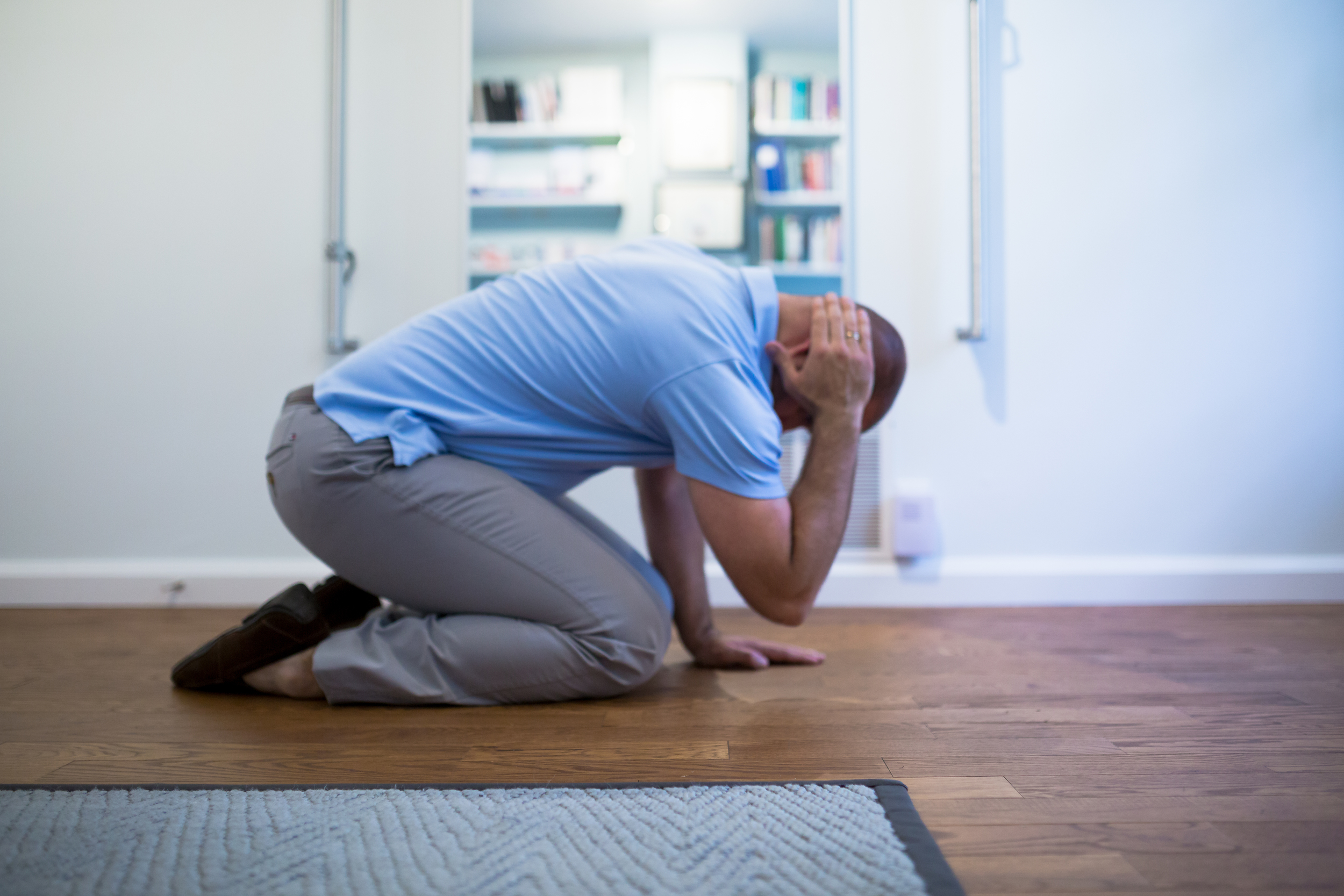 STEP 2:  Take your right arm off the floor and gently place your hand behind your ear. Make sure you keep your weight evenly distributed between your legs and your left hand on the floor. Take a breath, inhale and then as you exhale begin moving towards Step 3.