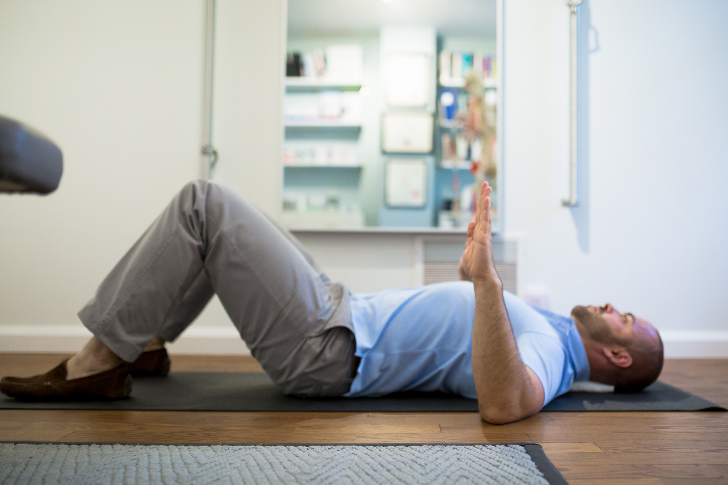 STEP 3:  As you maintain the abdominal brace and shoulder blade squeeze, bring your elbows to the floor next to your shoulders. As you keep your body braced, push your spine against the towel and your elbows against the floor.