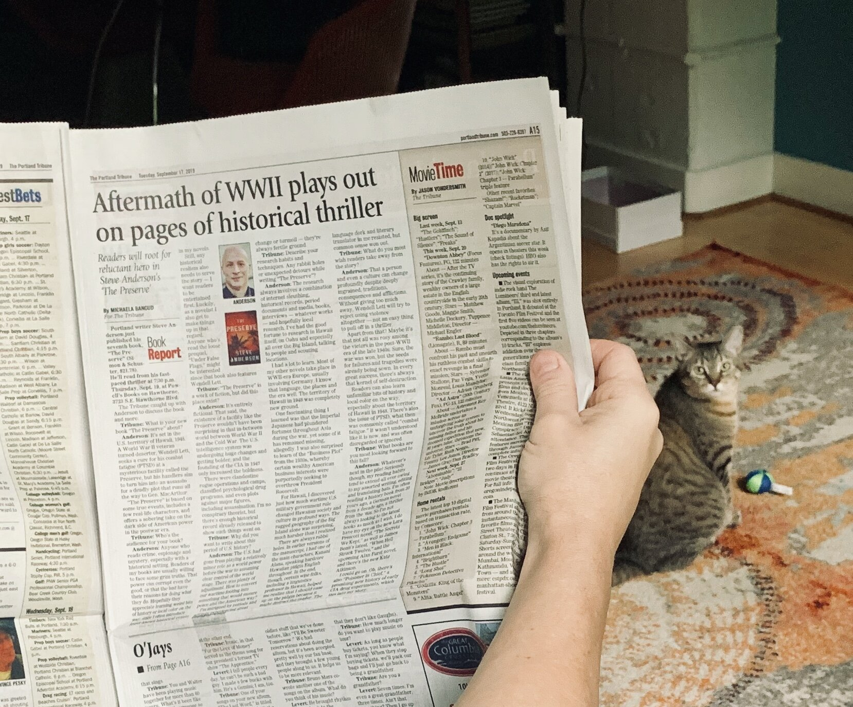 Our cat Trina approves of print media
