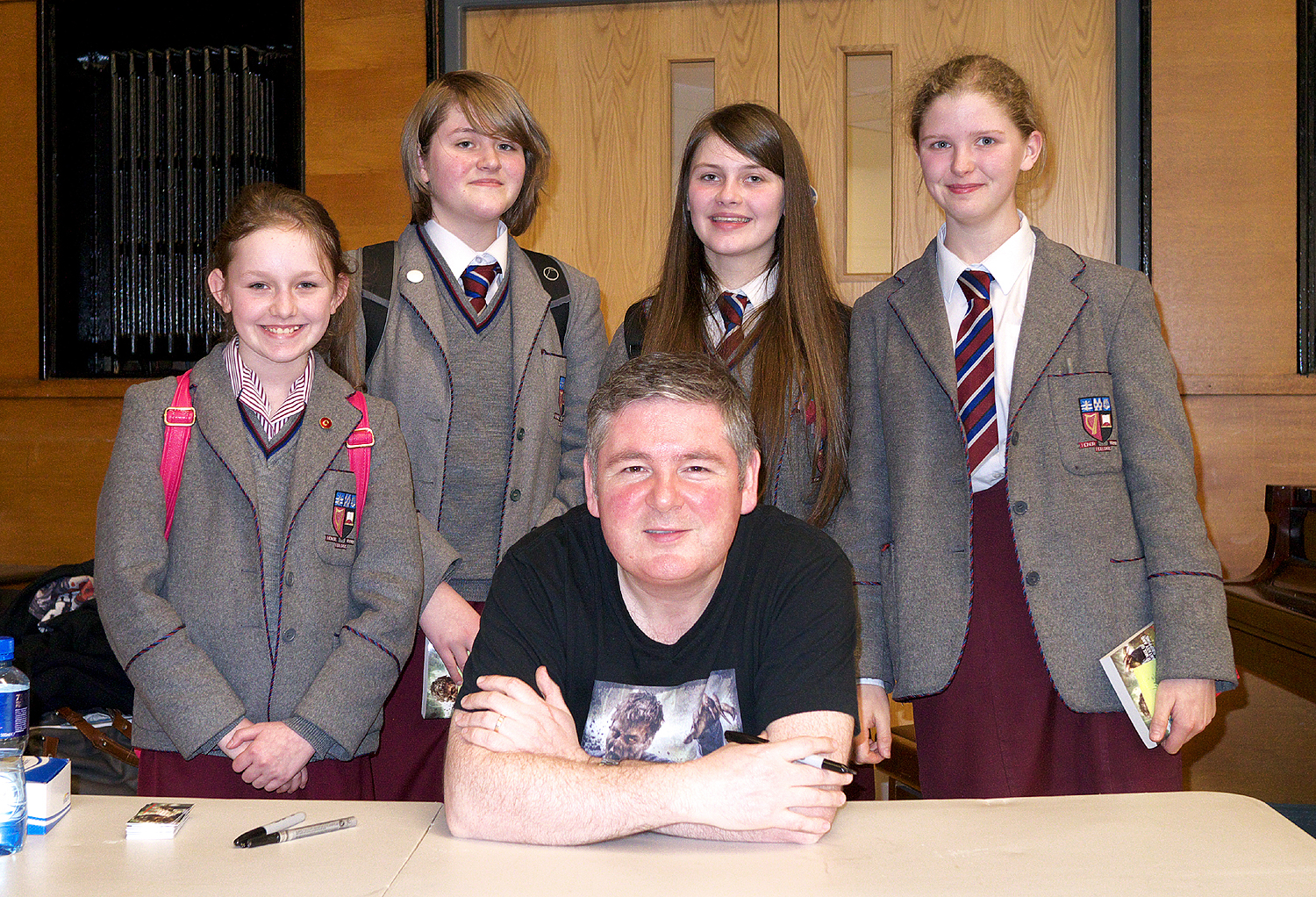 On Monday 7th April 2014 nine students travelled to Methodist College to see the author Darren Shan.  A popular writer of teenage horror fiction, Darren was in Belfast to promote his  Zom-B   series of books. Although full of blood and gore, the book  s combine clever plots with thought provoking moral questions such as dealing with racism and abuse of power.   After an enthralling talk, the pupils got to meet Darren and get books signed by him.