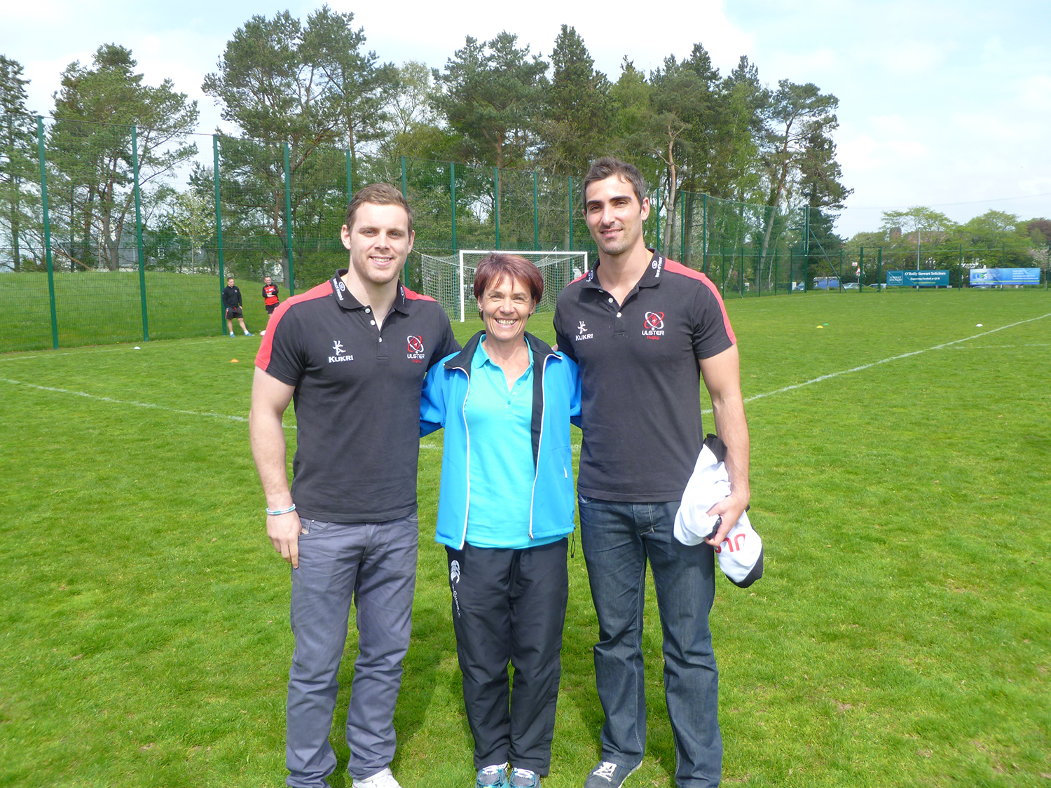 Ulster rugby players with PE teacher Miss Stewart